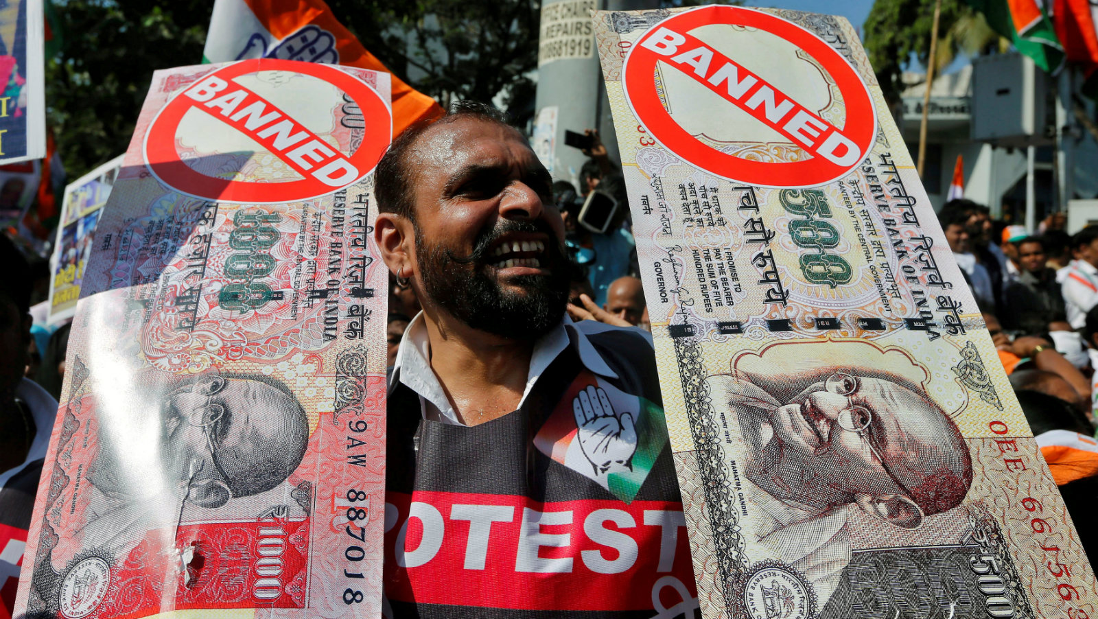 A man holds placards and shouts slogans during a rally organized by India's main opposition...
