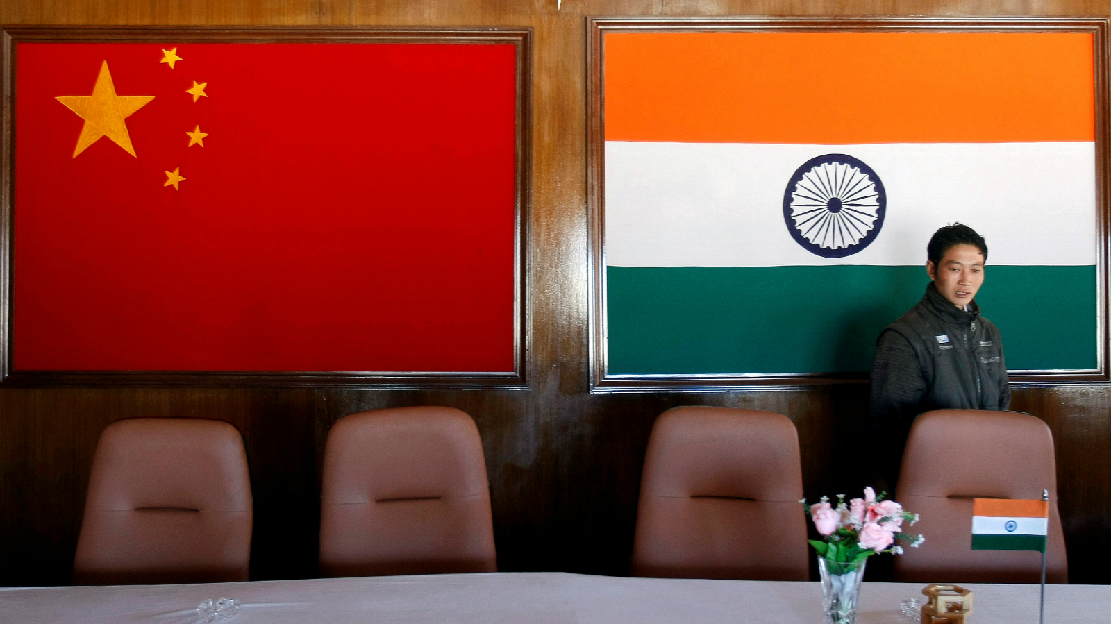 A man walks inside a conference room used for meetings between military commanders of China and India, at the Indian side of the Indo-China border at Bumla, in the northeastern Indian state of Arunachal Pradesh, November 11, 2009.