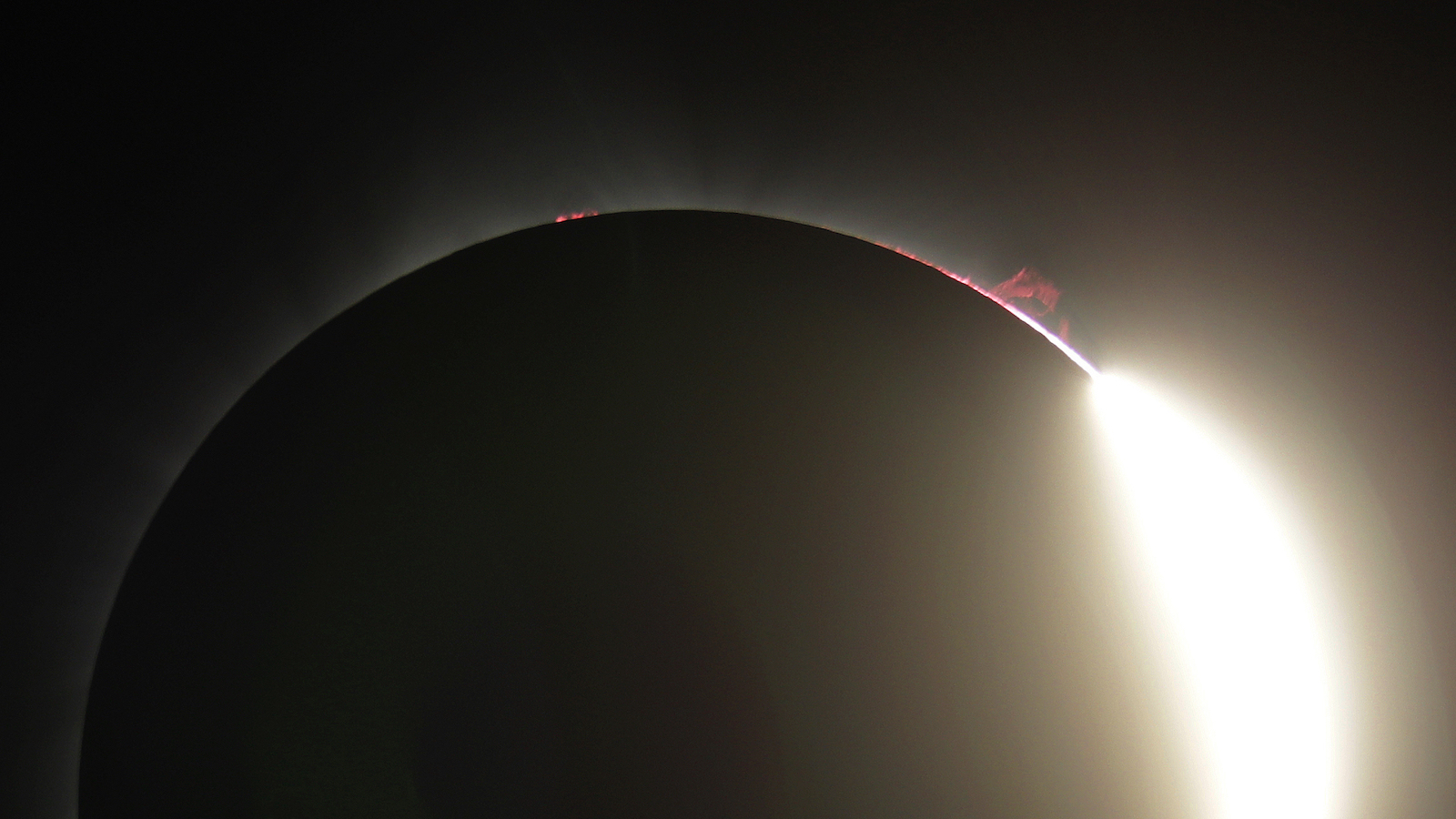 Solar activity can be seen as the sun emerges from a total eclipse by the moon, Monday, Aug. 21, 2017, near Redmond, Ore. (AP Photo/Ted S. Warren)