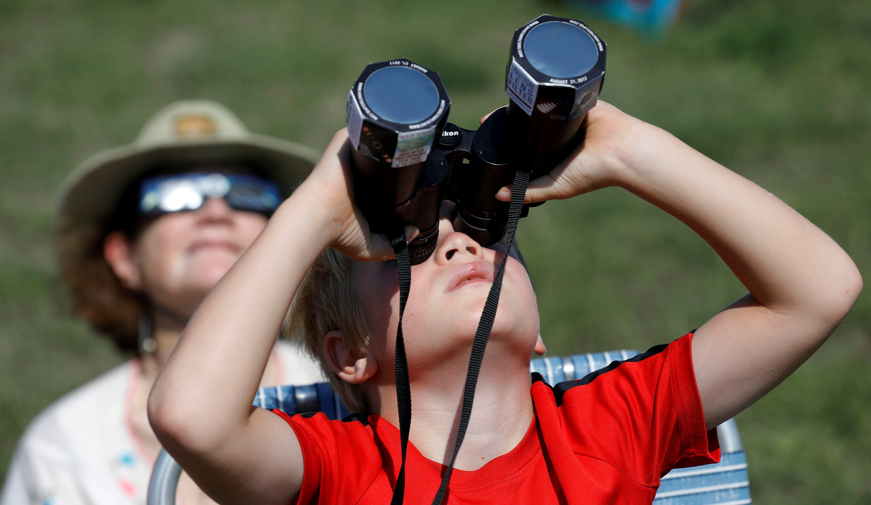 Rafi Davis, 7, of Sliver Springs, MD., watches the solar eclipse at Carhenge in Alliance