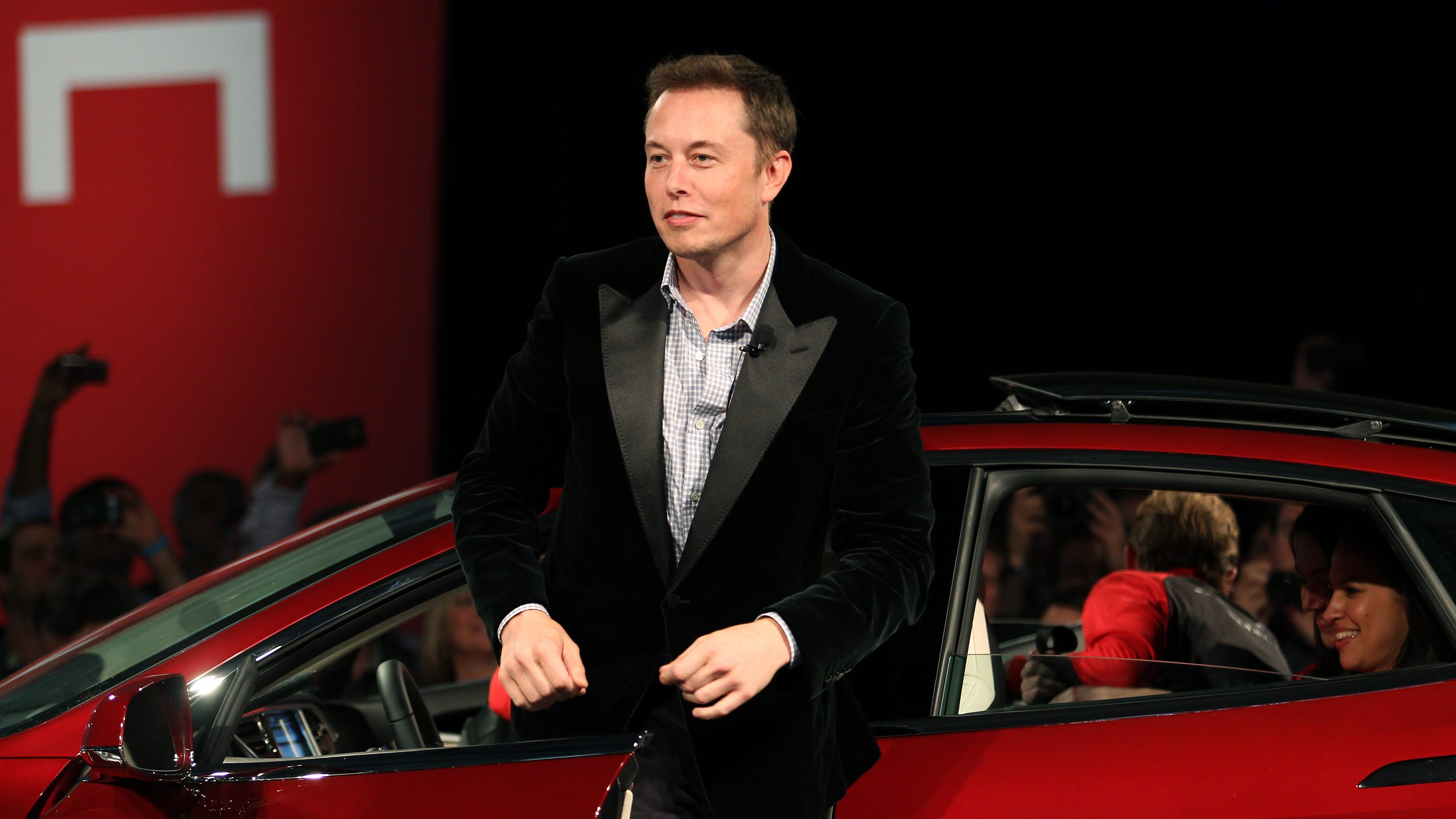 Tesla Motors CEO Elon Musk alights from a Model S, the company's first full-size electric sedan, during an event held at the Tesla factory in Fremont, California October 1, 2011. Tesla is hanging much of its future on the Model S, its first sedan, which it hopes to start delivering to customers next year.  REUTERS/Stephen Lam  (UNITED STATES - Tags: BUSINESS TRANSPORT SCIENCE TECHNOLOGY) - RTR2S40T