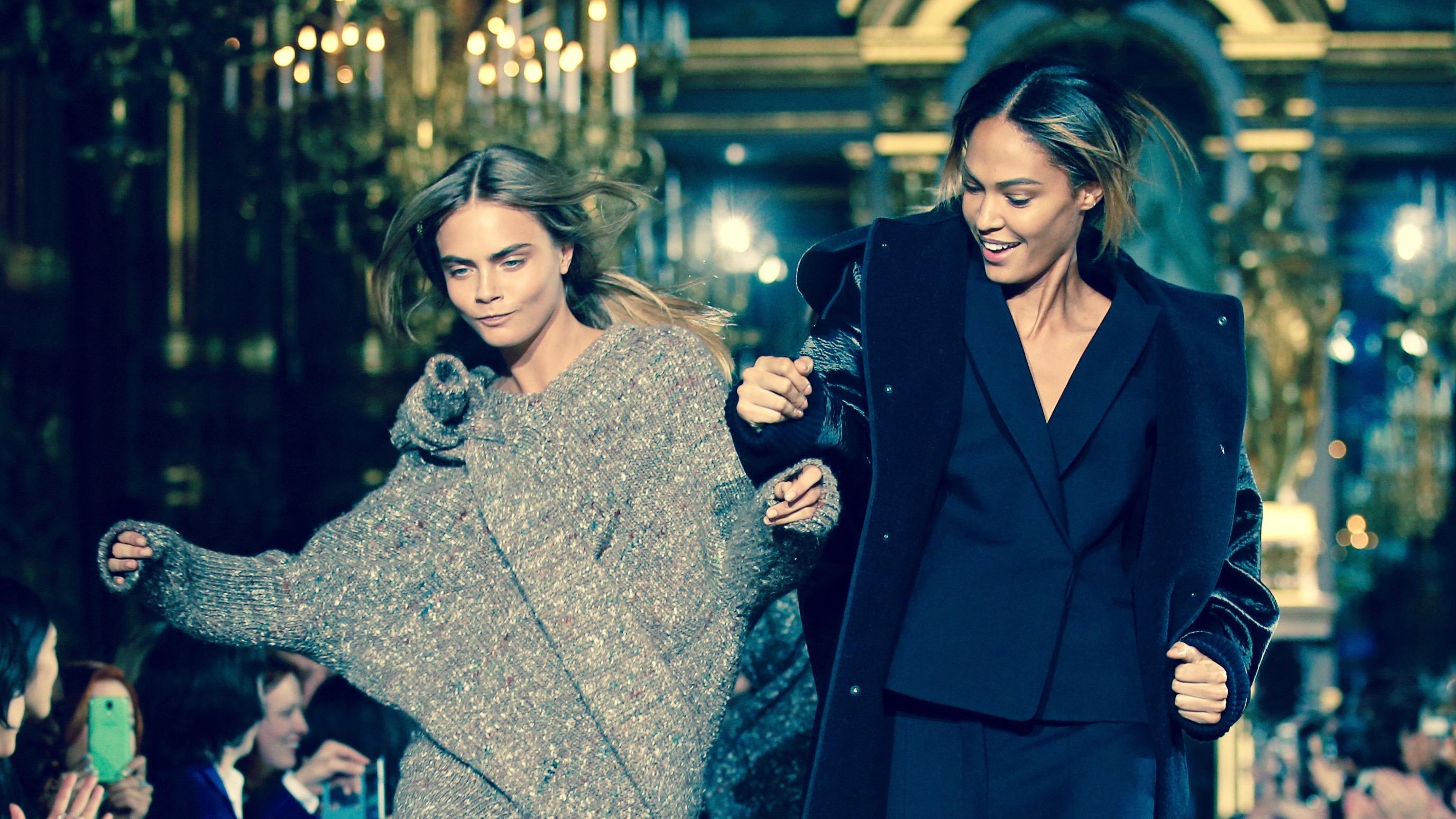 Models Cara Delevingne and Joan Smalls on the runway.