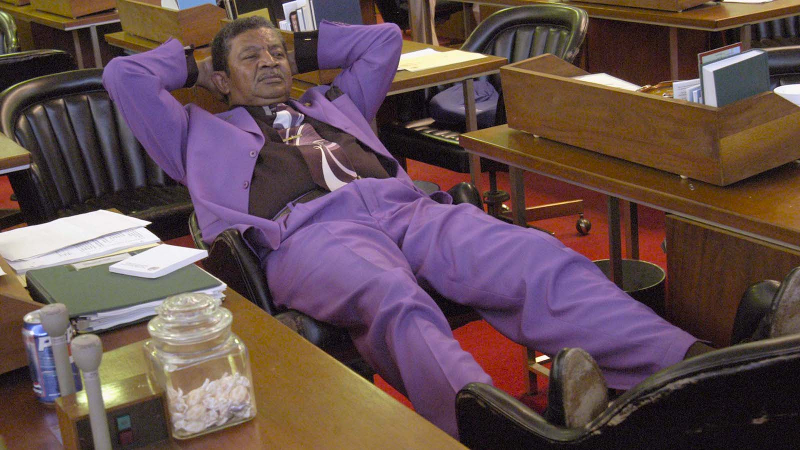 Rep. Larry Womble, D-Forsyth, puts his feet up at his desk on the floor of the House in Raleigh, N.C., Sunday, July 20, 2003, during one of the many recesses as the General Assembly works towards adjournment. (AP Photo/Karen Tam)