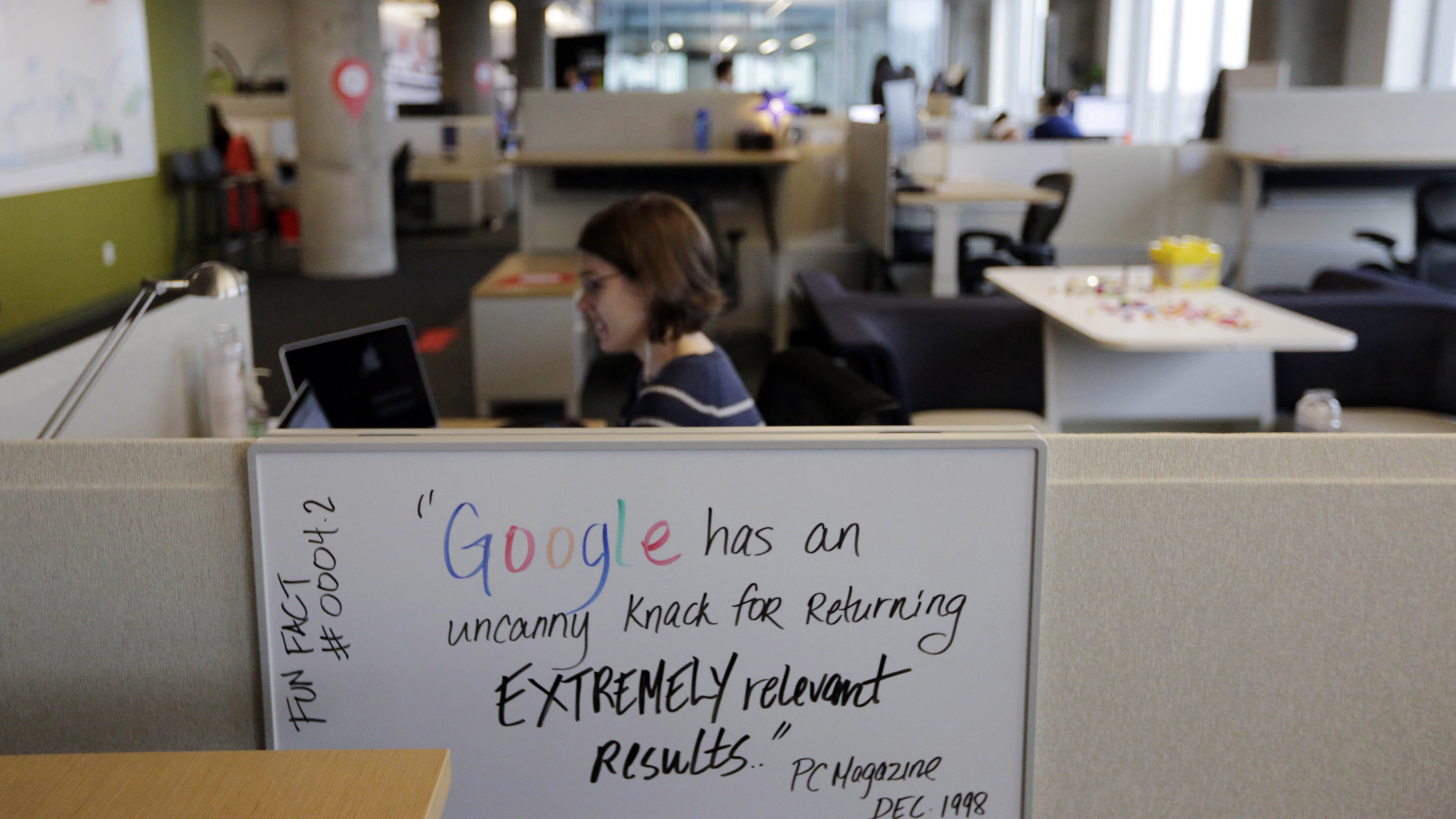 An employee works in the new Google Chicago Headquarters Thursday, Dec. 3, 2015, in Chicago. The new offices occupy about 200,000 square feet and house a staff of around 650 full time employees. (AP Photo/M. Spencer Green)