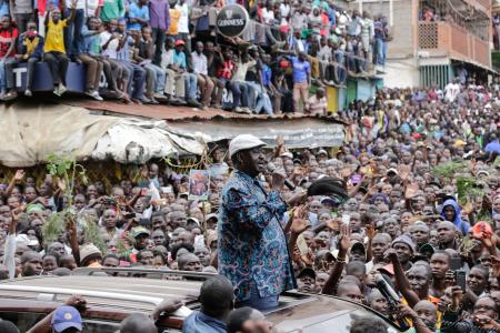 Kenyan opposition leader Raila Odinga (C) addresses thousands of his supporters after visiting the family of a young girl killed by a stray bullet during protest between opposition supporters and riot police in Mathare North, in Nairobi, Kenya, 13 August 2017. The rights group Kenya National Commission on Human Rights stated that at least 24 people have been killed in nationwide protests which erupted immediately after the electoral commission announced Kenyatta as the winner, while opposition claims the security forces killed more than 100 people. Kenyans across the nation are praying for peace on 13 August as the normalcy returns to areas that have experienced days of violence.