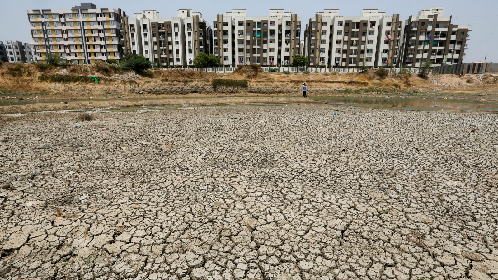 Residential apartments are seen next to the dried-up Ratanpura lake on the outskirts of Ahmedabad.