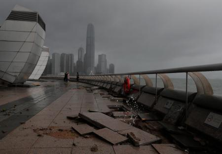 Debris caused by Typhoon Hato damage is strewn across the waterfront of Victoria Habour in Hong Kong, Wednesday, Aug. 23, 2017. A powerful typhoon barreled into Hong Kong on Wednesday, forcing offices and schools to close and leaving flooded streets, shattered windows and hundreds of canceled flights in its wake. (AP Photo/Vincent Yu)