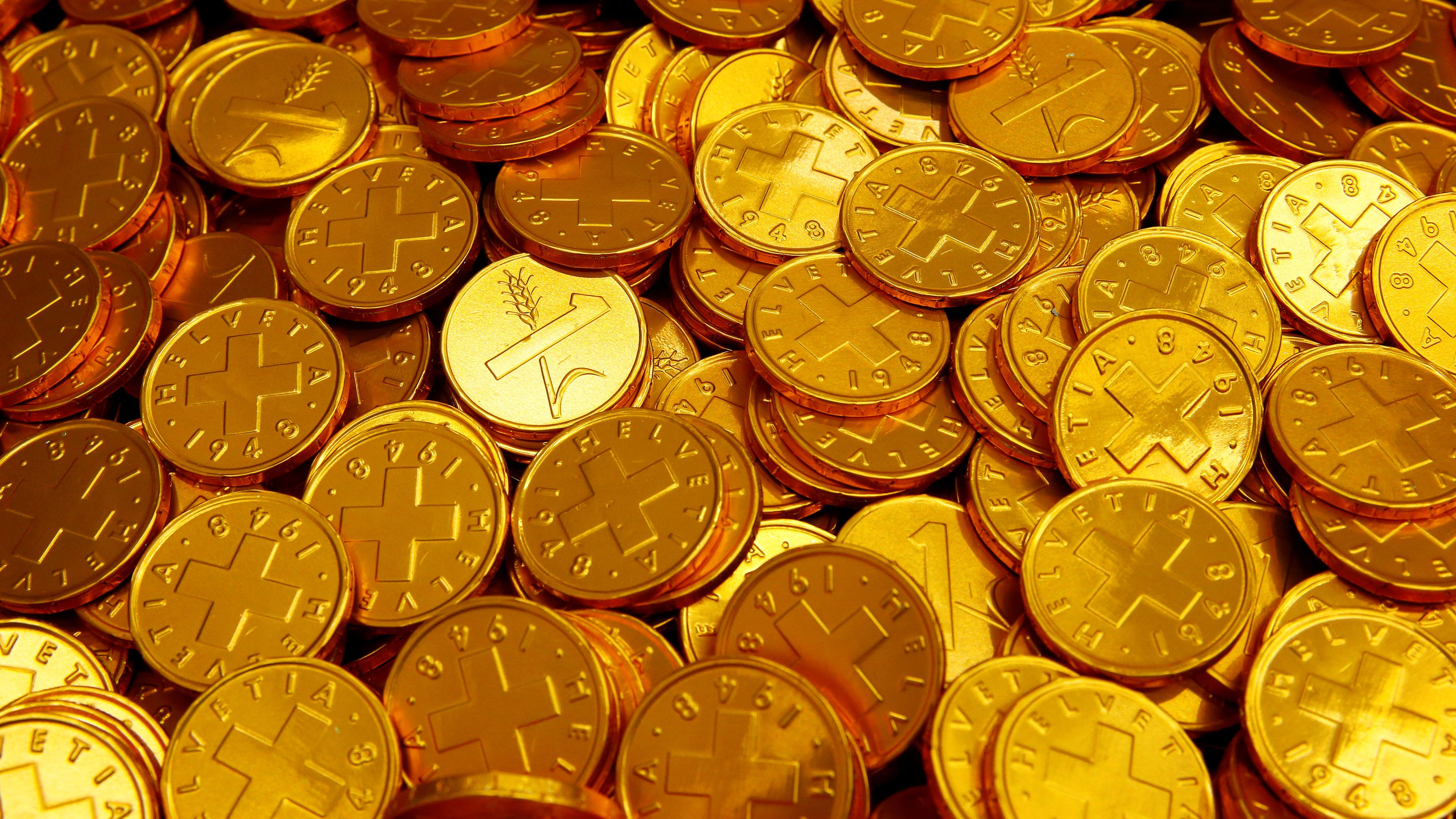 Chocolate coins are seen at the factory of Swiss chocolate manufacturer Aeschbach Chocolatier AG in Root-Luzern, Switzerland July 21, 2017.