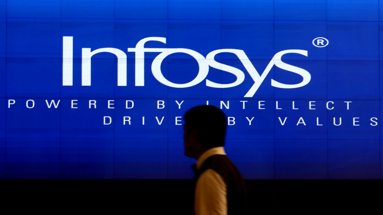Indian software specialists enter the Infosys headquarters, in Bangalore, India, 15 July 2016, where Infosys CEO and Managing Director Vishal Sikka (unseen) announced the company's Q1 results earlier on the same day. The Indian second largest information technology and consulting company reported net profit grew 13 percent, cutting its outlook after the first quarter earnings came in below estimates. The company and its expected to have its revenue growth between 10.5 to 12 percent in constant currency terms. Sikka has set the goal to raise the company's revenue to 20 billion US dollars by 2020.