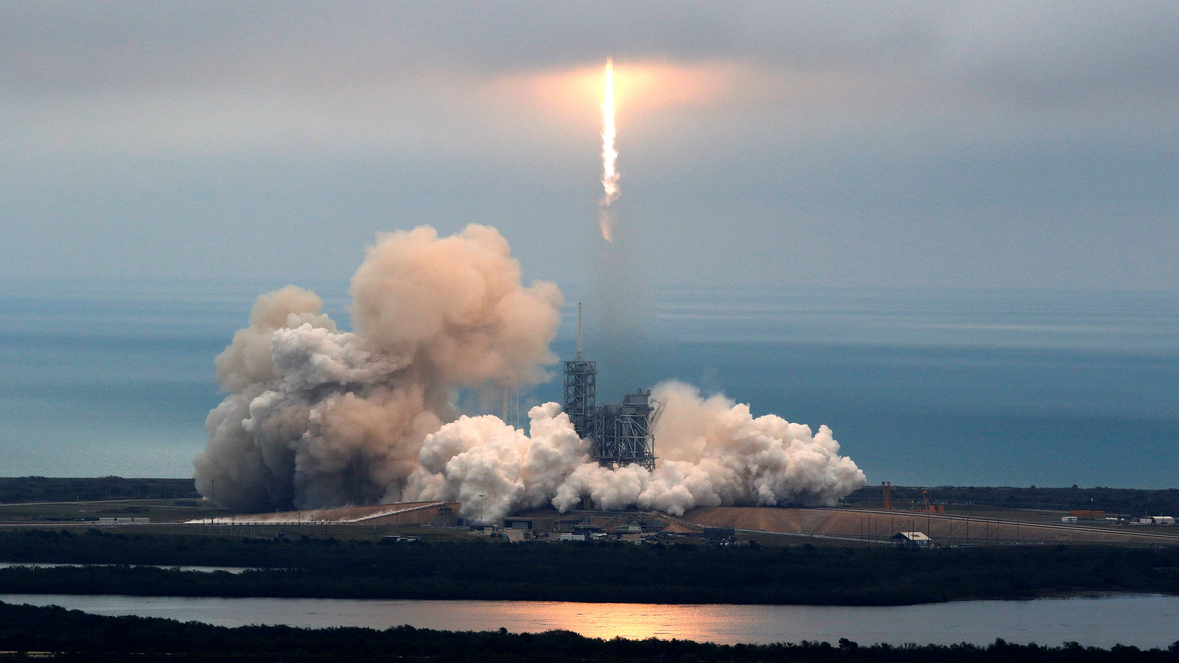A rocket launch into space traveling to the international space station.