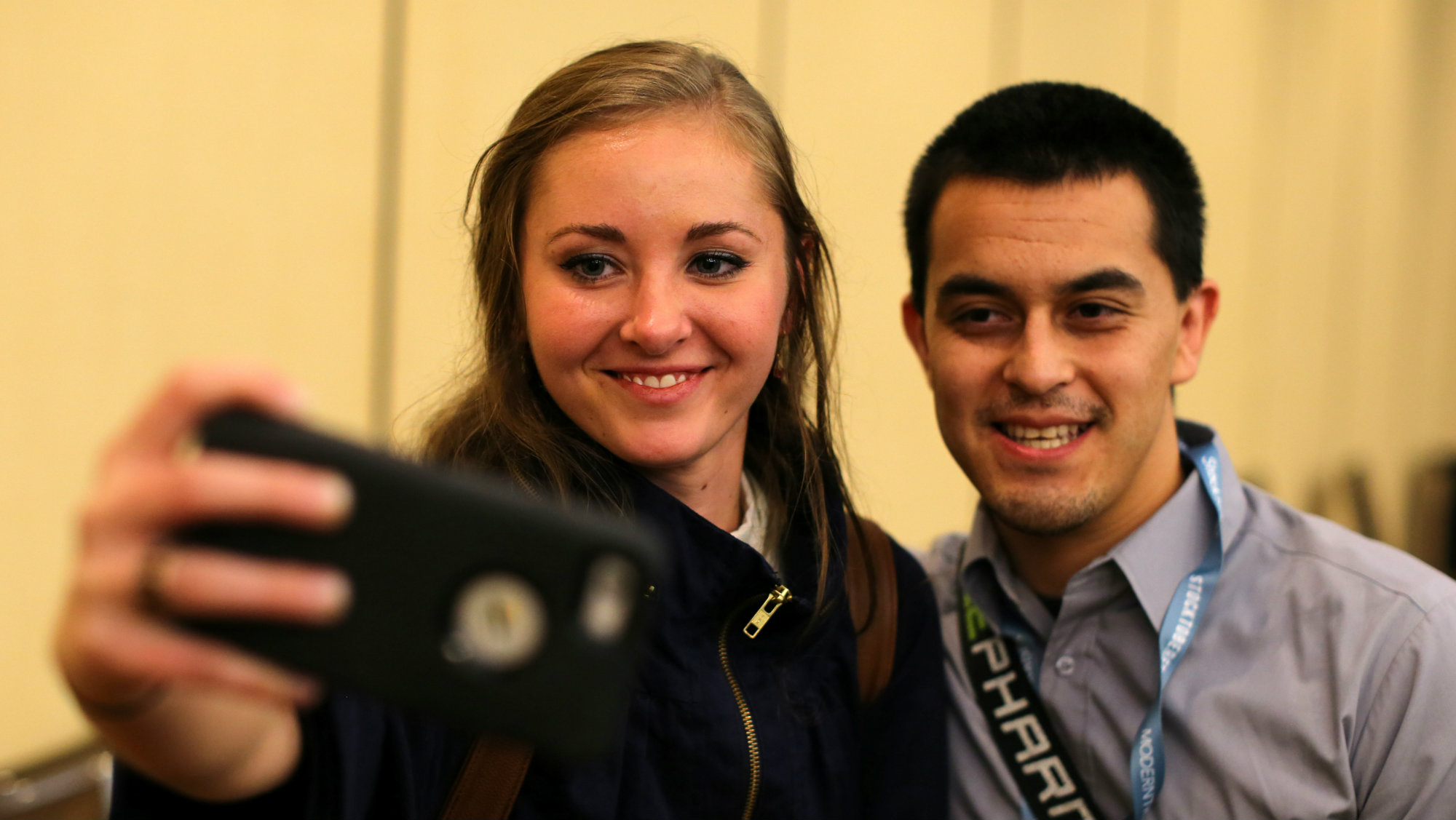 Millennial stock blogger and trader Rachel Fox, 20, is asked to take a picture with a fan after speaking to a group of investors, tech nerds and stock traders at StockTwits annual Stocktoberfest in Coronado, California, U.S. October 14, 2016.
