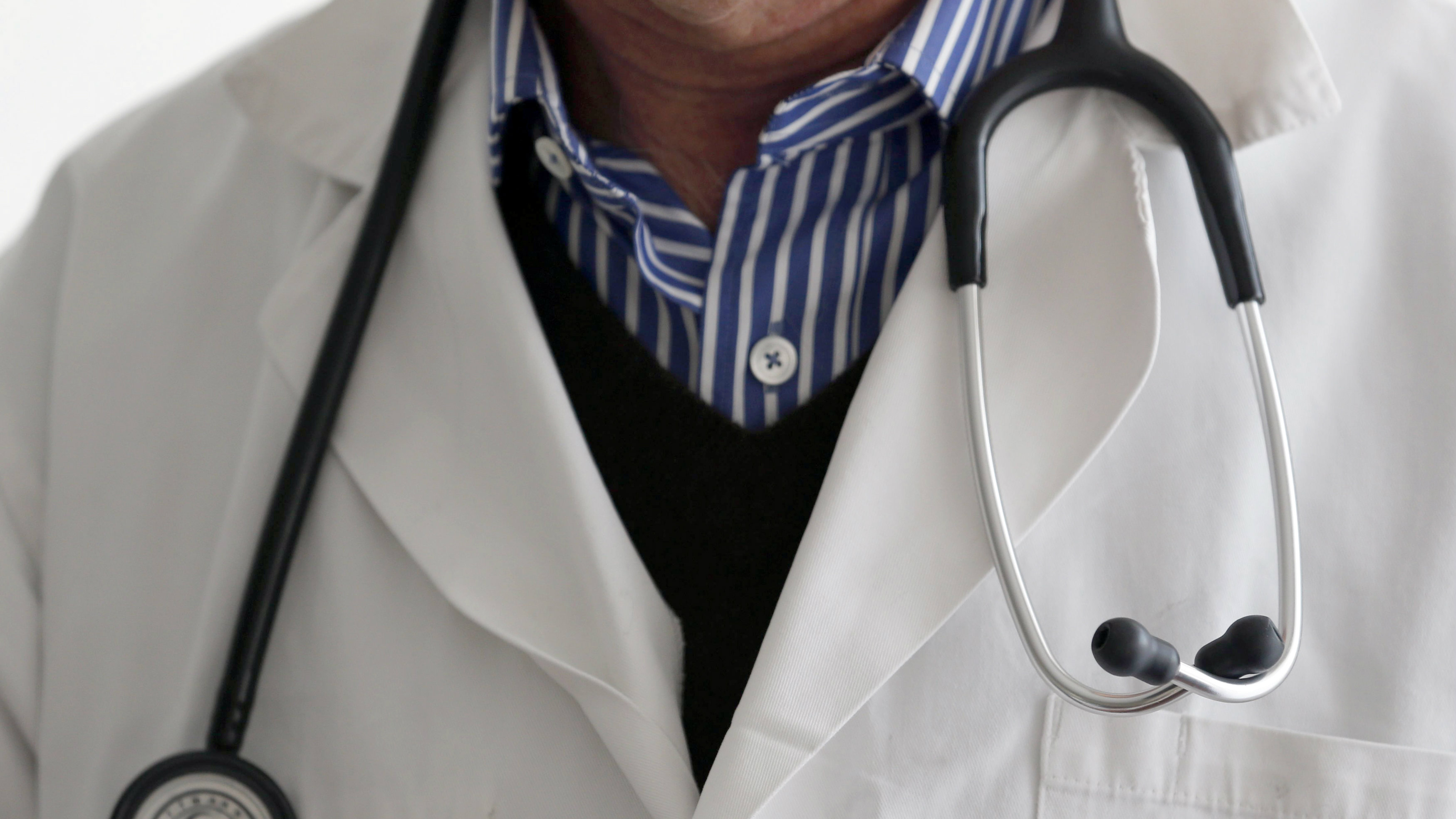 A photo illustration shows a French general practitioner with a stethoscope in a doctor's office in Bordeaux January 7, 2015. French physicians protest against a new health reform bill that would introduce a third party payment system. Picture taken January 7, 2015. REUTERS/Regis Duvignau (FRANCE - Tags: HEALTH POLITICS)