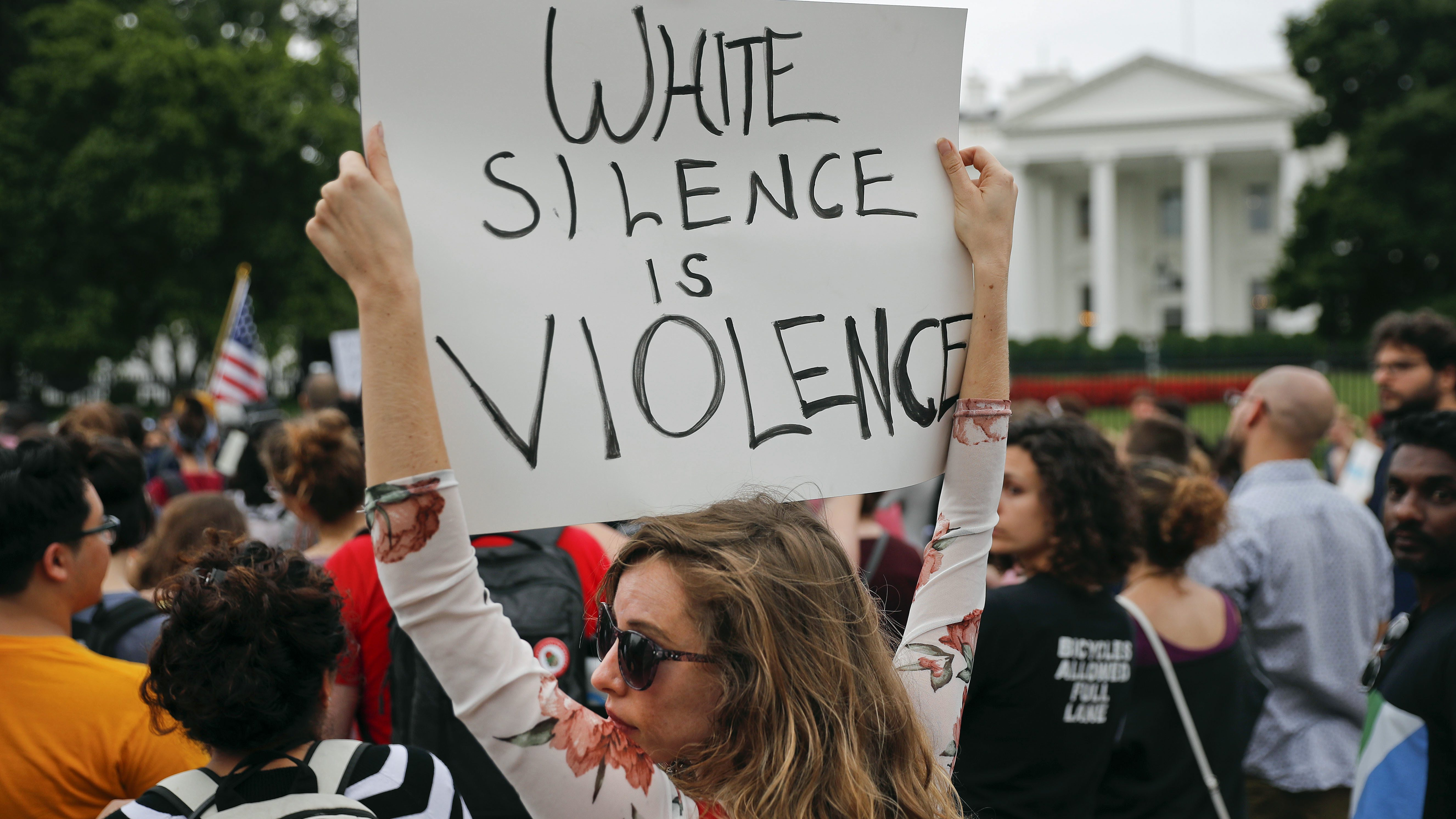 Demonstrators gather on Pennsylvania Avenue in front of the White House in Washington, Monday, Aug. 14, 2017. For the second night in a row, people gathered in front of the White House to protest the white nationalist rally in Charlottesville, Va. (AP Photo/Pablo Martinez Monsivais)
