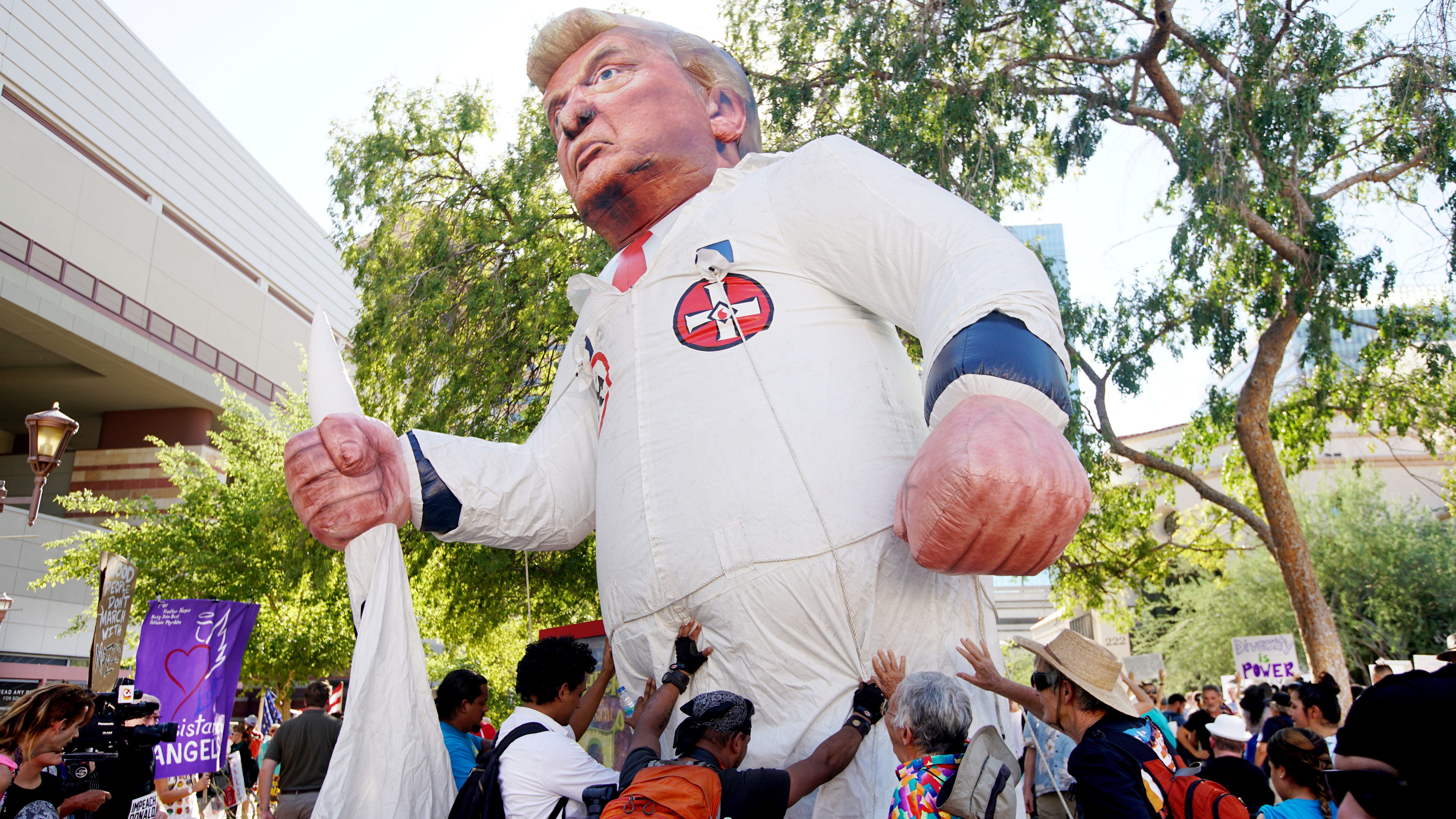 protests outside a Donald Trump campaign rally in Phoenix,