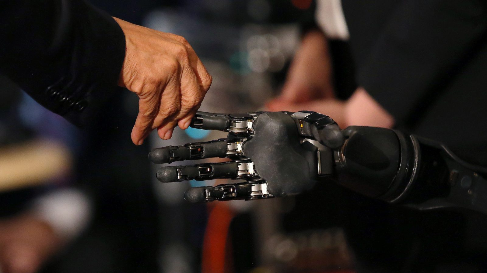 A robot and human hand touch.