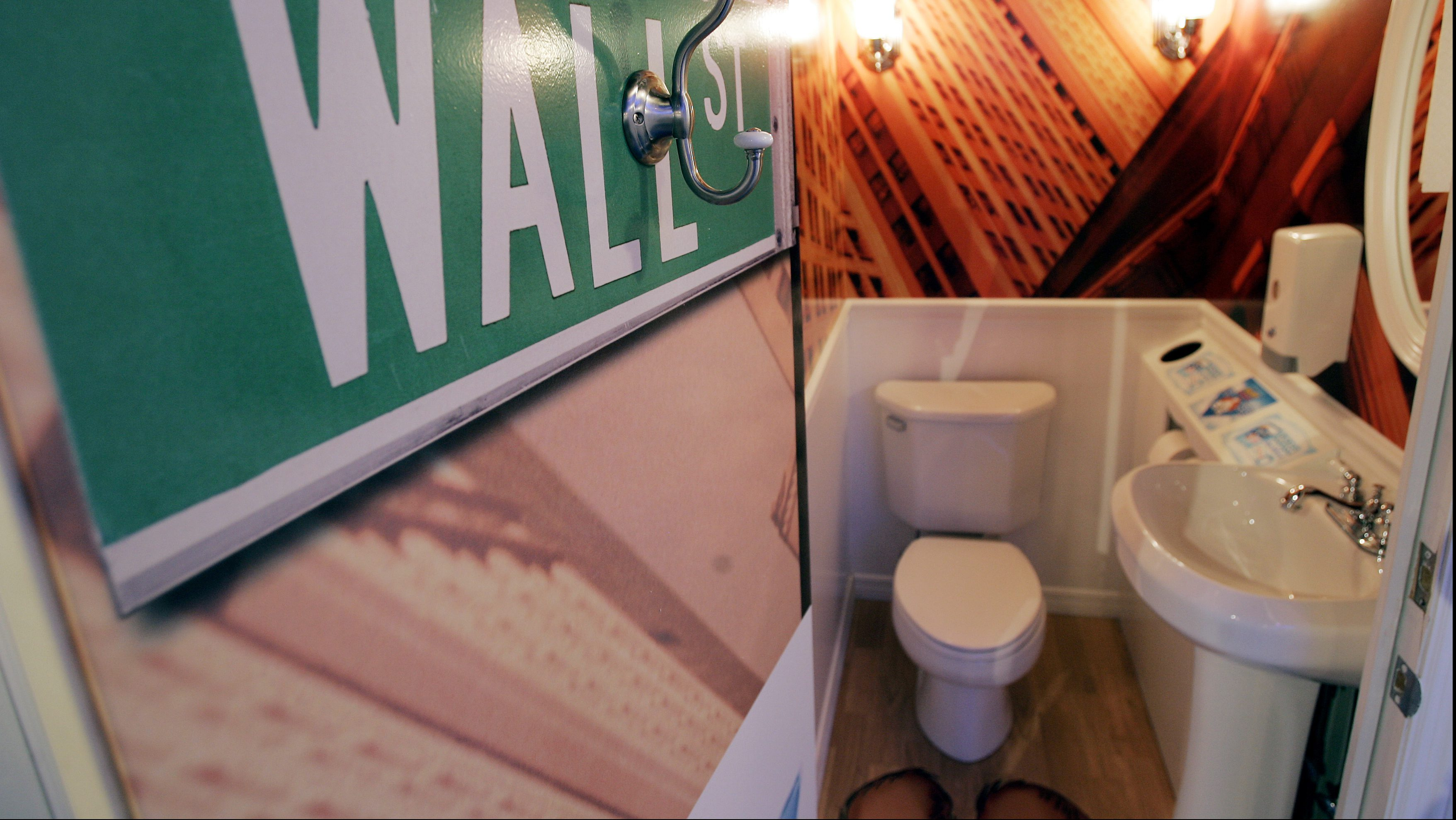 A Wall Street themed bathroom, one of 20 free public bathroom units that will be open for the holiday shopping season, is seen in New York's Times Square November 20, 2006. Toilet paper company Charmin built the public restrooms that will be available for free at a formerly vacant warehouse in Times Square. REUTERS/Mike Segar (UNITED STATES) - RTR1JJI8