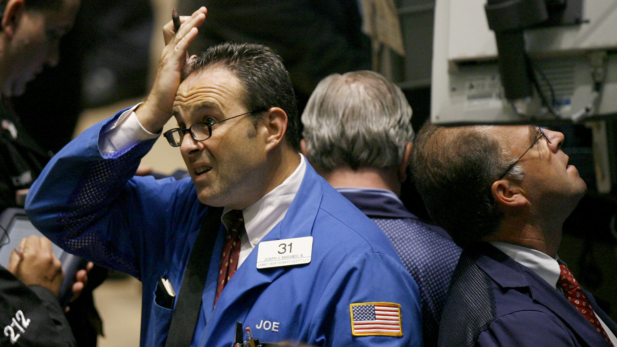 Traders work on the floor of the New York Stock Exchange August 9, 2007