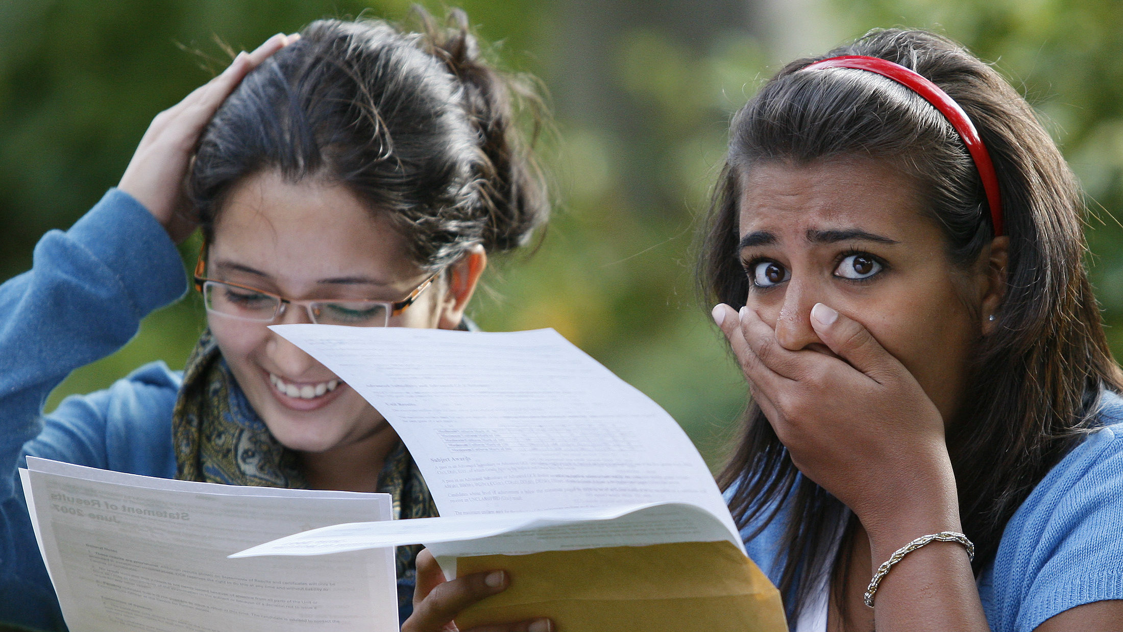 Students looking at their exam results