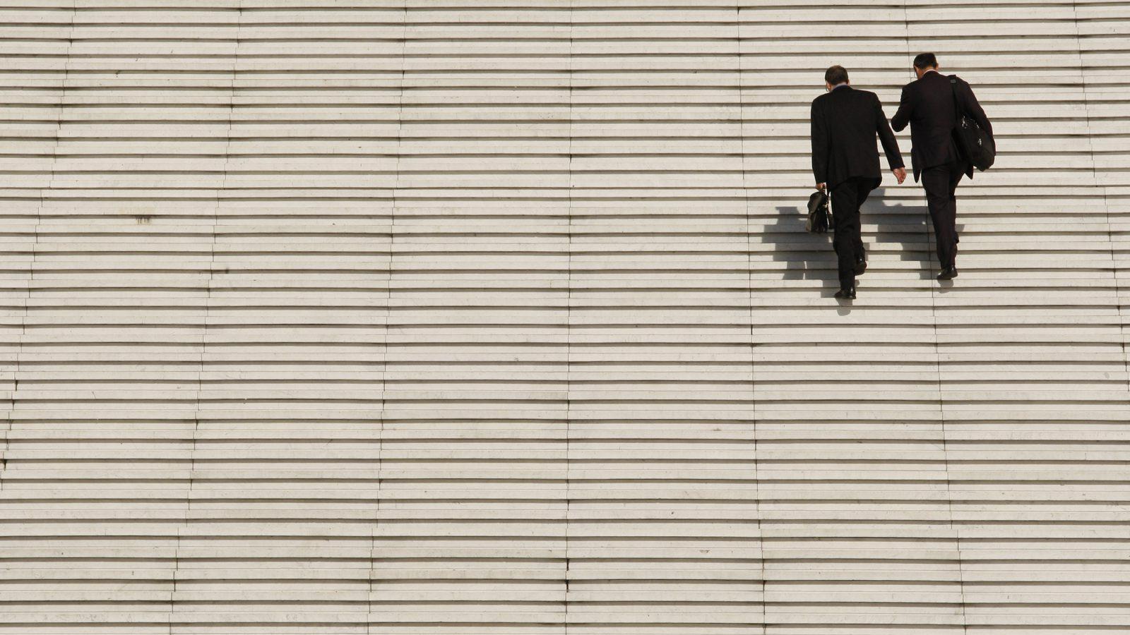 businessmen climbing stairs