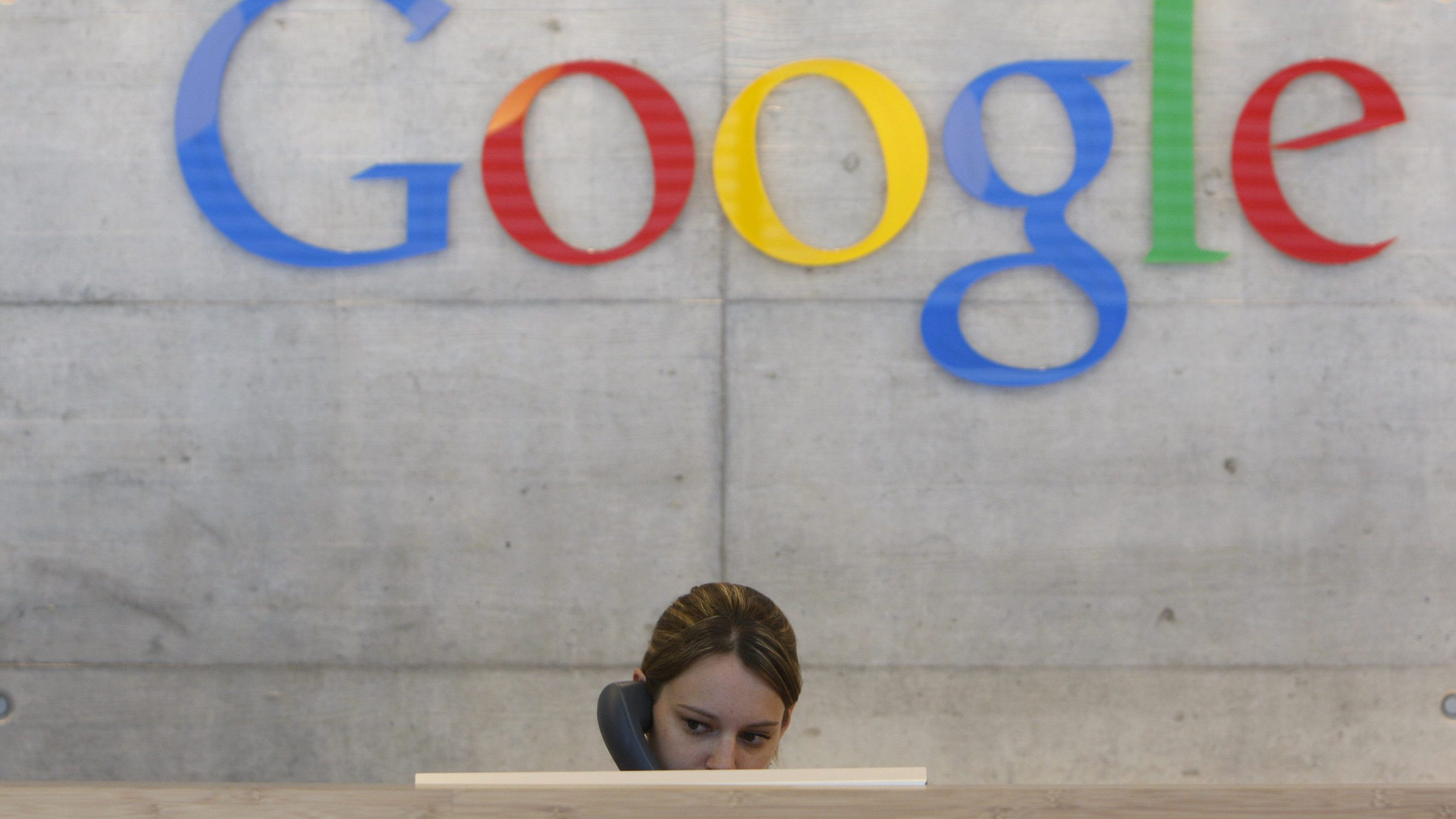 An employee answers phone calls at the switchboard of the Google office in Zurich August 18, 2009. This logo has been updated and is no longer in use.