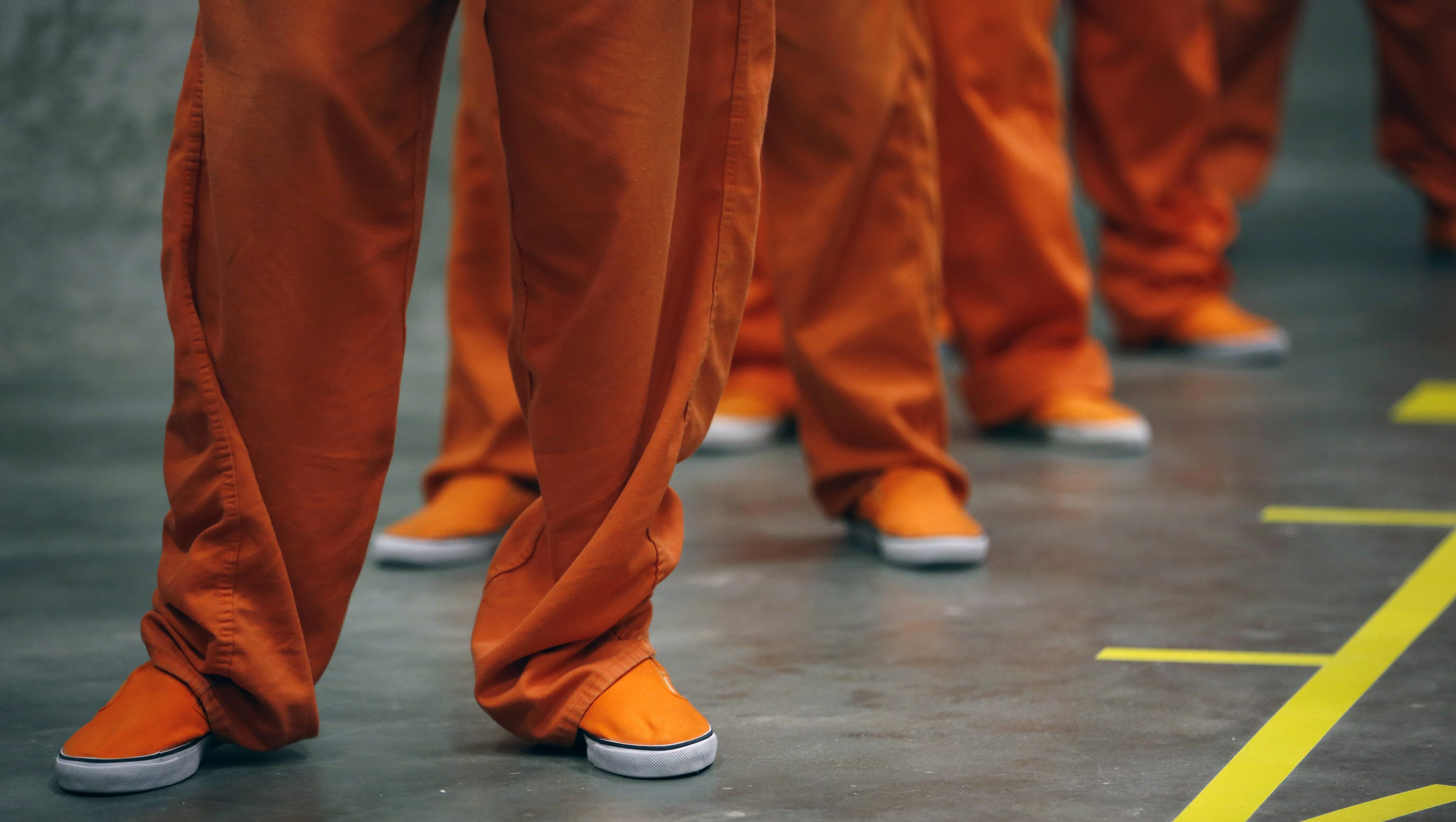 Prison inmates stand in line as they prepare to dance in opposition of violence against women as they participate in a One Billion Rising event at the San Francisco County Jail #5 on Valentine's Day in San Bruno, California February 14, 2013. The event, with participants from 250 countries performing a choreographed dance routine on a day associated with romantic love, aims to raise awareness about violence against women in which one in three women across the globe will be raped or beaten in their lifetime. REUTERS/Stephen Lam (UNITED STATES - Tags: SOCIETY) - RTR3DT6Q