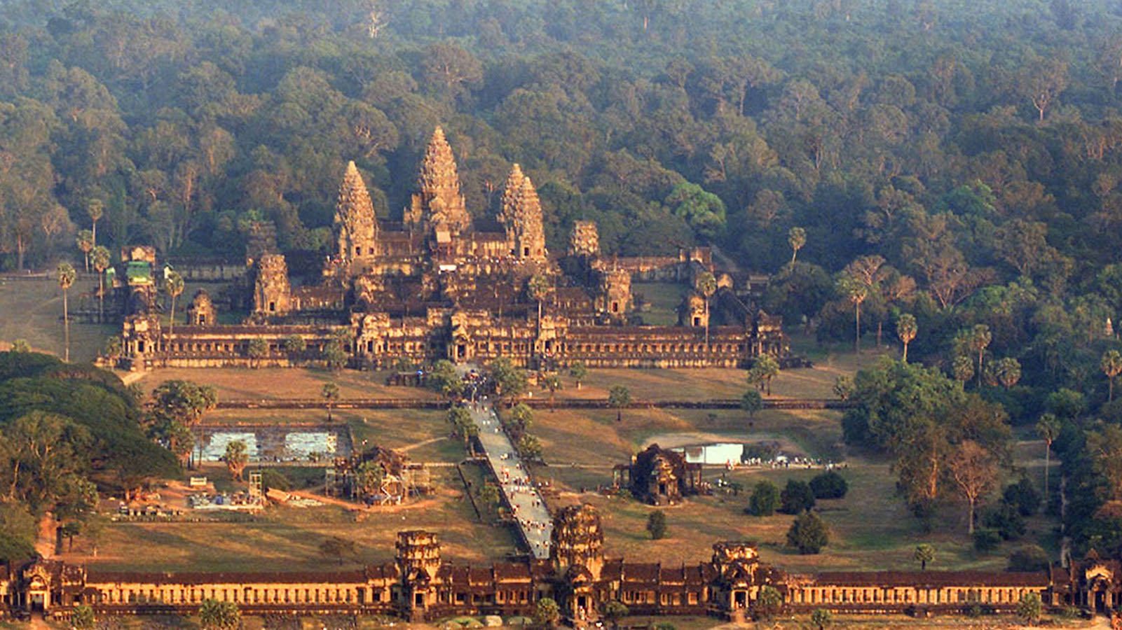 Cambodia's Angkor Wat temple basks in evening sunlight on January 12, 2003, viewed from a new tethered air balloon on January 12, 2003, some 200 metres (655 feet) above the Angkor Wat temples in northwest Cambodia. The vast 800-year-old temple complex is the jewel in the crown of the war-ravaged southeast Asian nation's nascent tourism industry, which attracted some 800,000 visitors in 2002 - a total which could rise to 2.2 million by 2006 if government forecasts are to be believed. Picture taken January 12, 2003. REUTERS/Chor Sokunthea  CS/RCS - RTRGGRQ