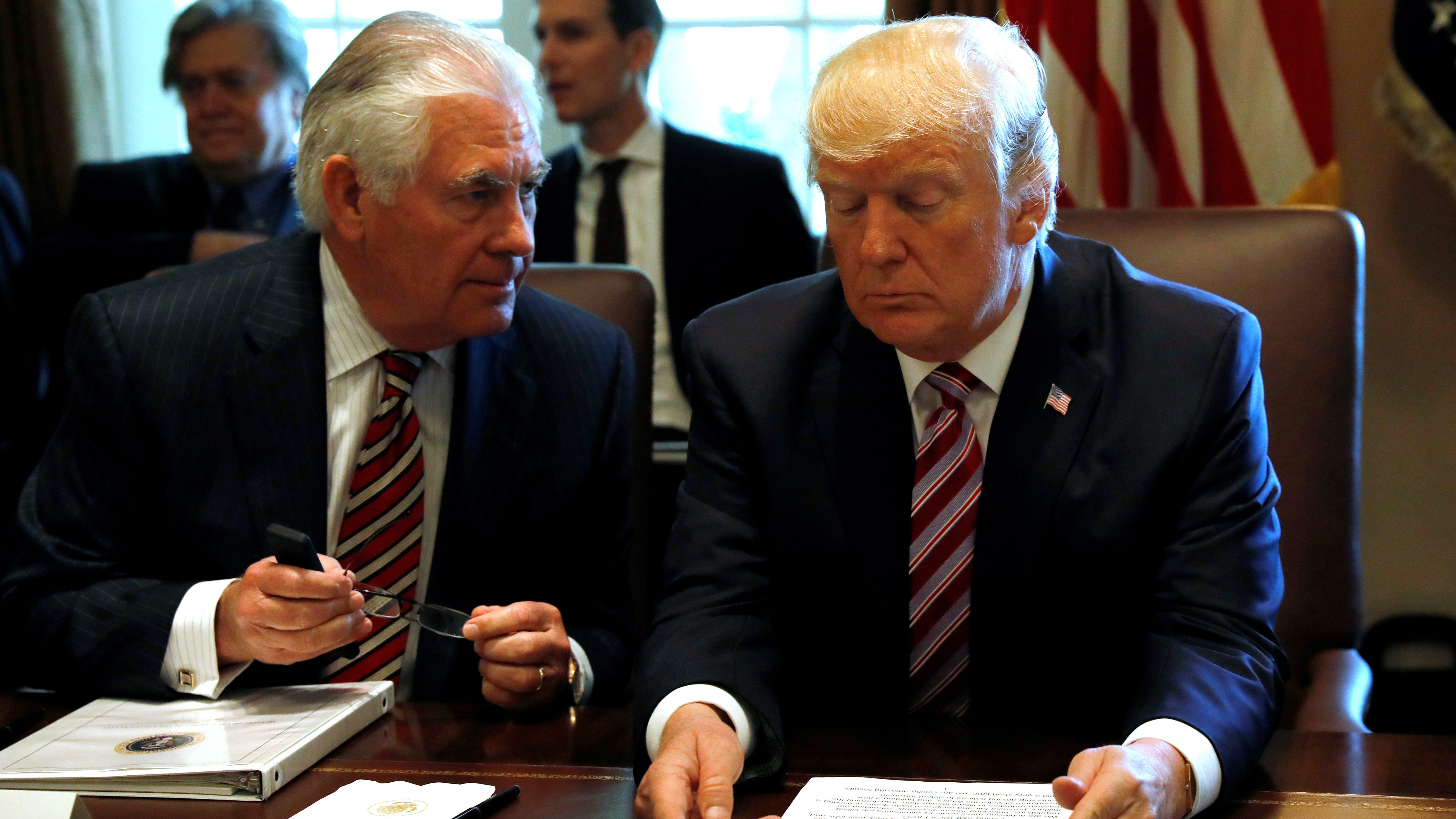 U.S. President Donald Trump talks with Secretary of State Rex Tillerson during a meeting with members of his Cabinet at the White House in Washington, U.S., June 12, 2017.  REUTERS/Kevin Lamarque - RTS16QQI