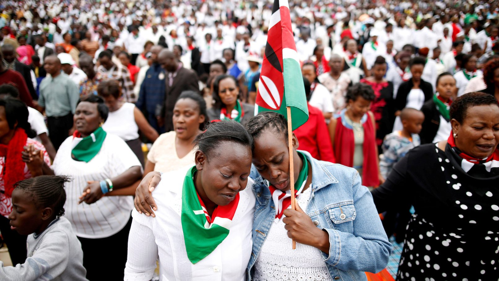 Kenyans pray during a rally calling for peace ahead of Kenya's August 8 election in Nairobi, Kenya July 30