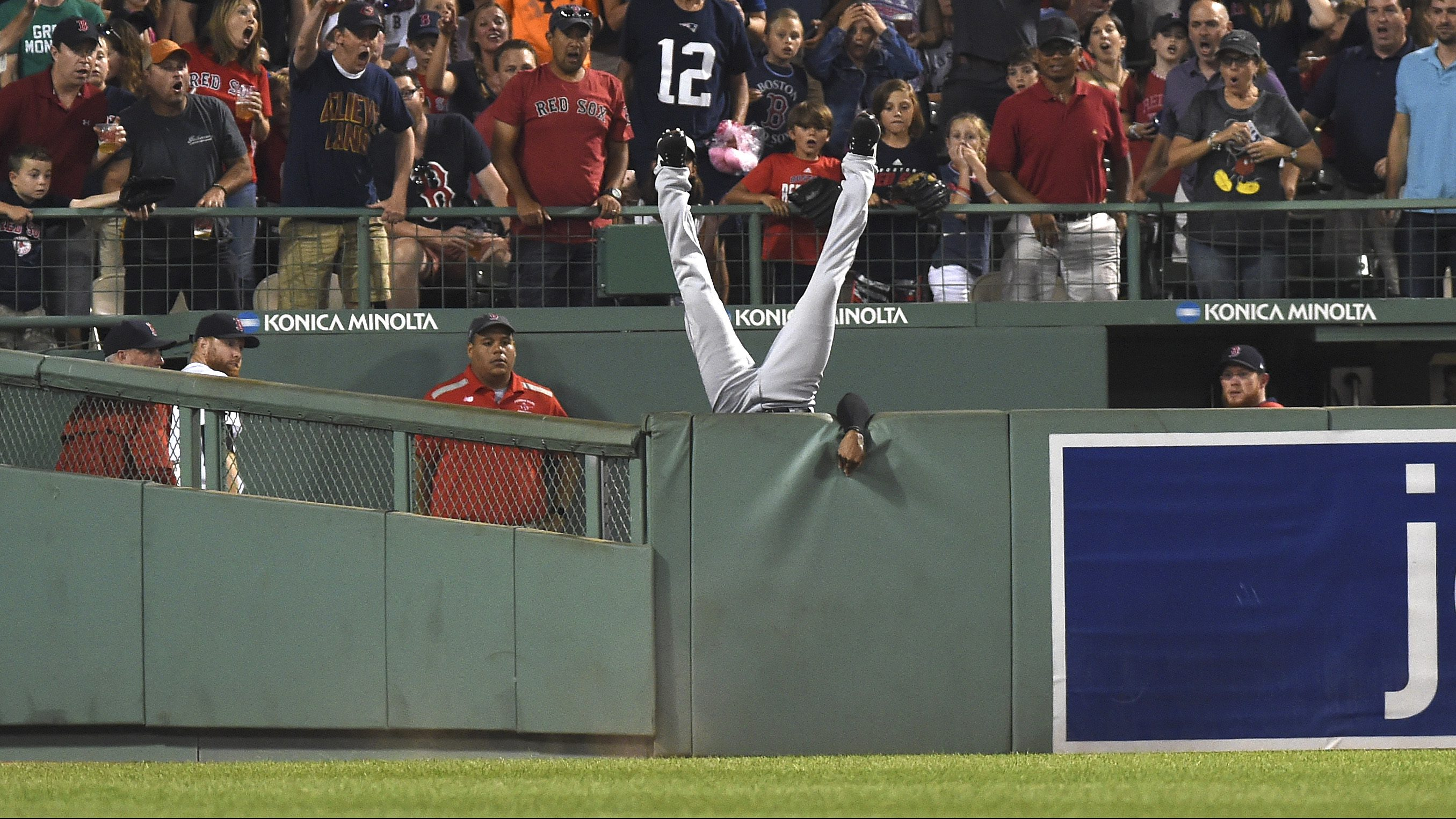 Aug 1, 2017; Boston, MA, USA; Cleveland Indians center fielder Austin Jackson (26) falls over the wall after making a catch to rob Boston Red Sox designated hitter Hanley Ramirez (not pictured) of a home run during the fifth inning at Fenway Park. Mandatory Credit: Bob DeChiara-USA TODAY Sports - RTS1A1H1