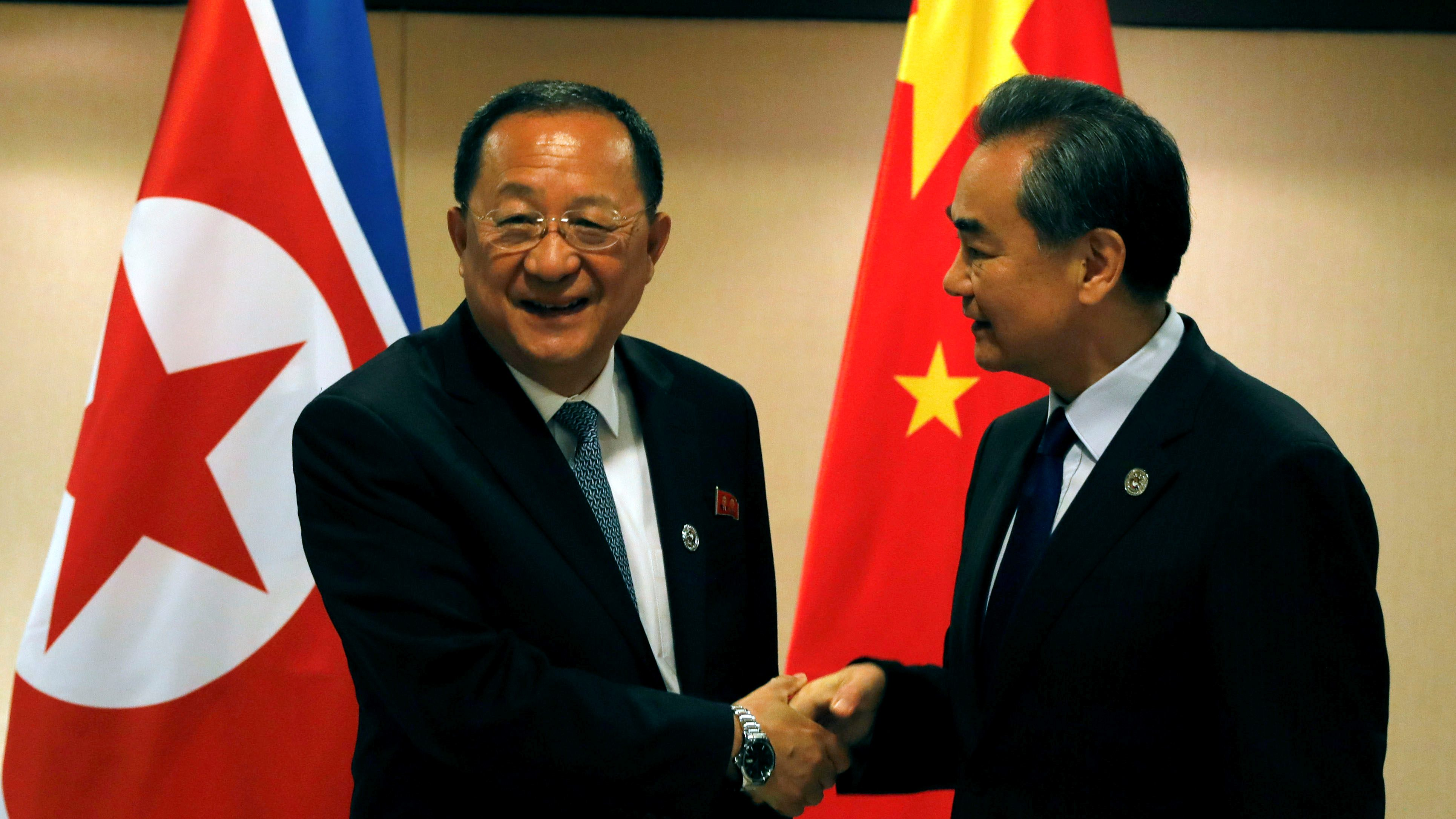 China's Foreign Minister Wang Yi (R) shakes hands with North Korea's Foreign Minister Ri Yong Ho before their bilateral meeting on the sidelines of the 50th Association of Southeast Asia Nations (ASEAN) Regional Forum (ARF) in Manila, Philippines August 6, 2017.