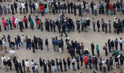 People queue outside a polling station to cast their vote during the presidential election in the city centre in Nairobi, Kenya,