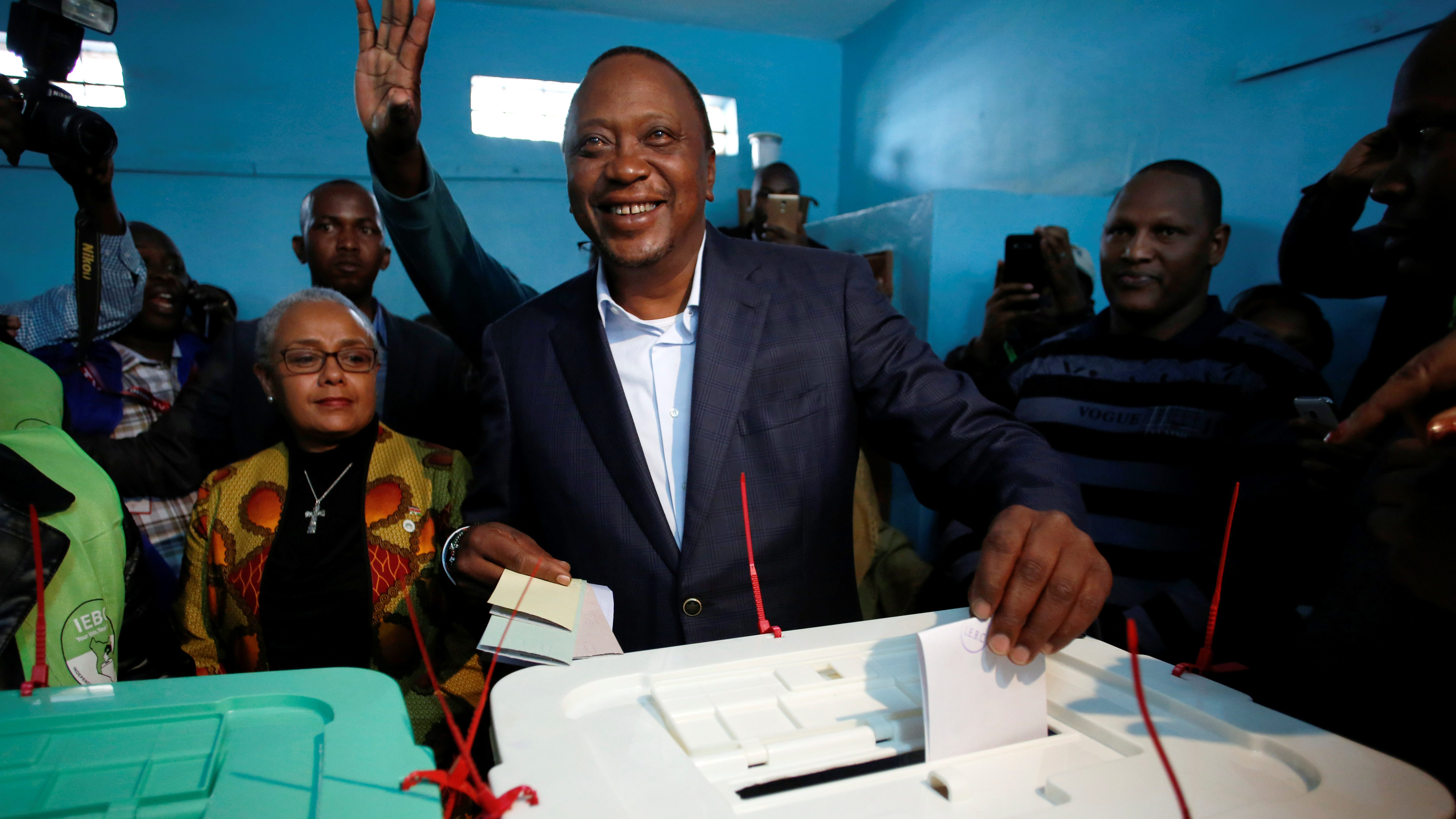 Kenya's President Uhuru Kenyatta casts his vote during the presidential election at a polling station in Gatundu, Kenya August 8, 2017.