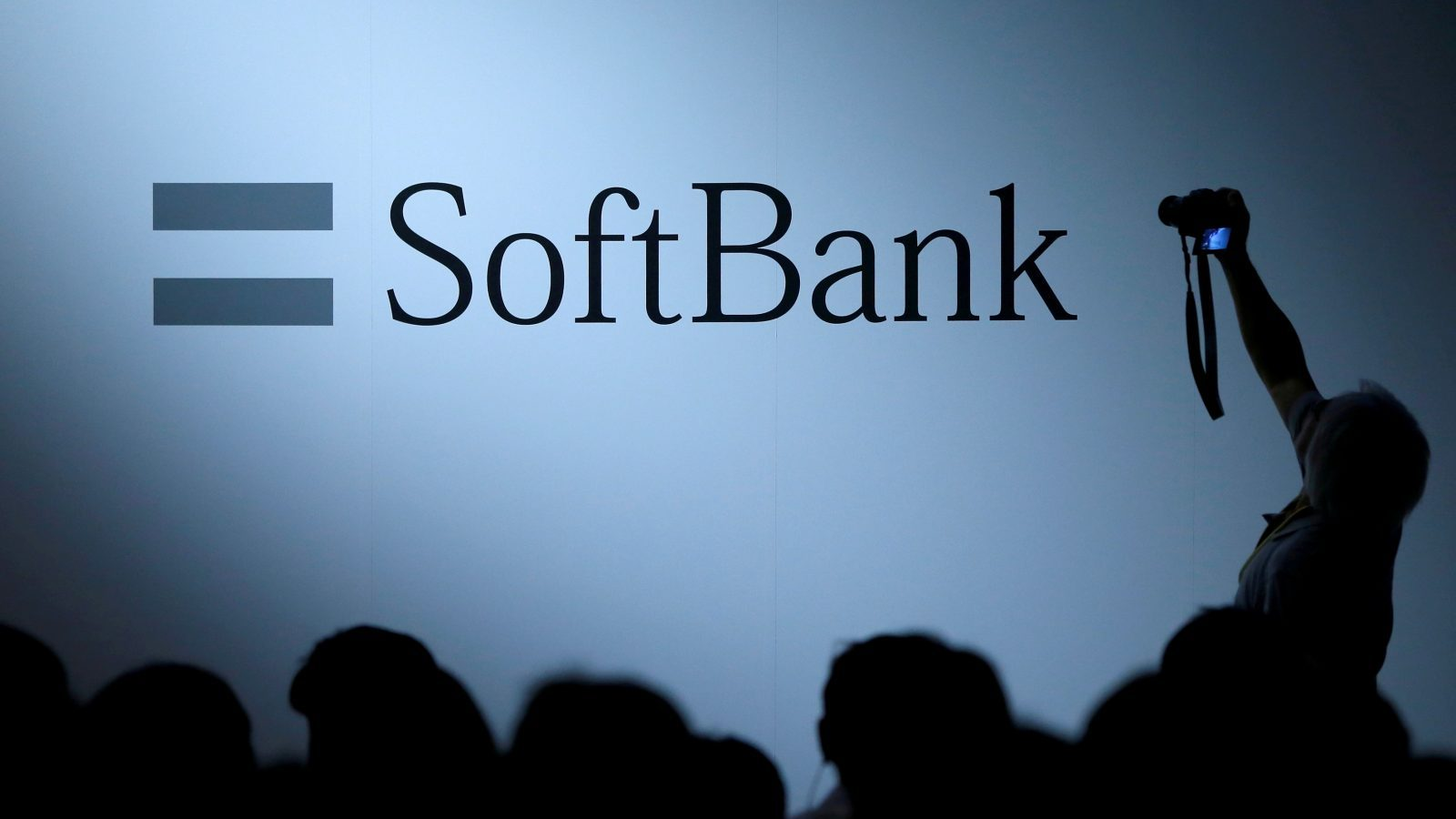FILE PHOTO: The logo of SoftBank Group Corp is displayed at SoftBank World 2017 conference in Tokyo, Japan, July 20, 2017. REUTERS/Issei Kato/File photo - RTS1B6HC