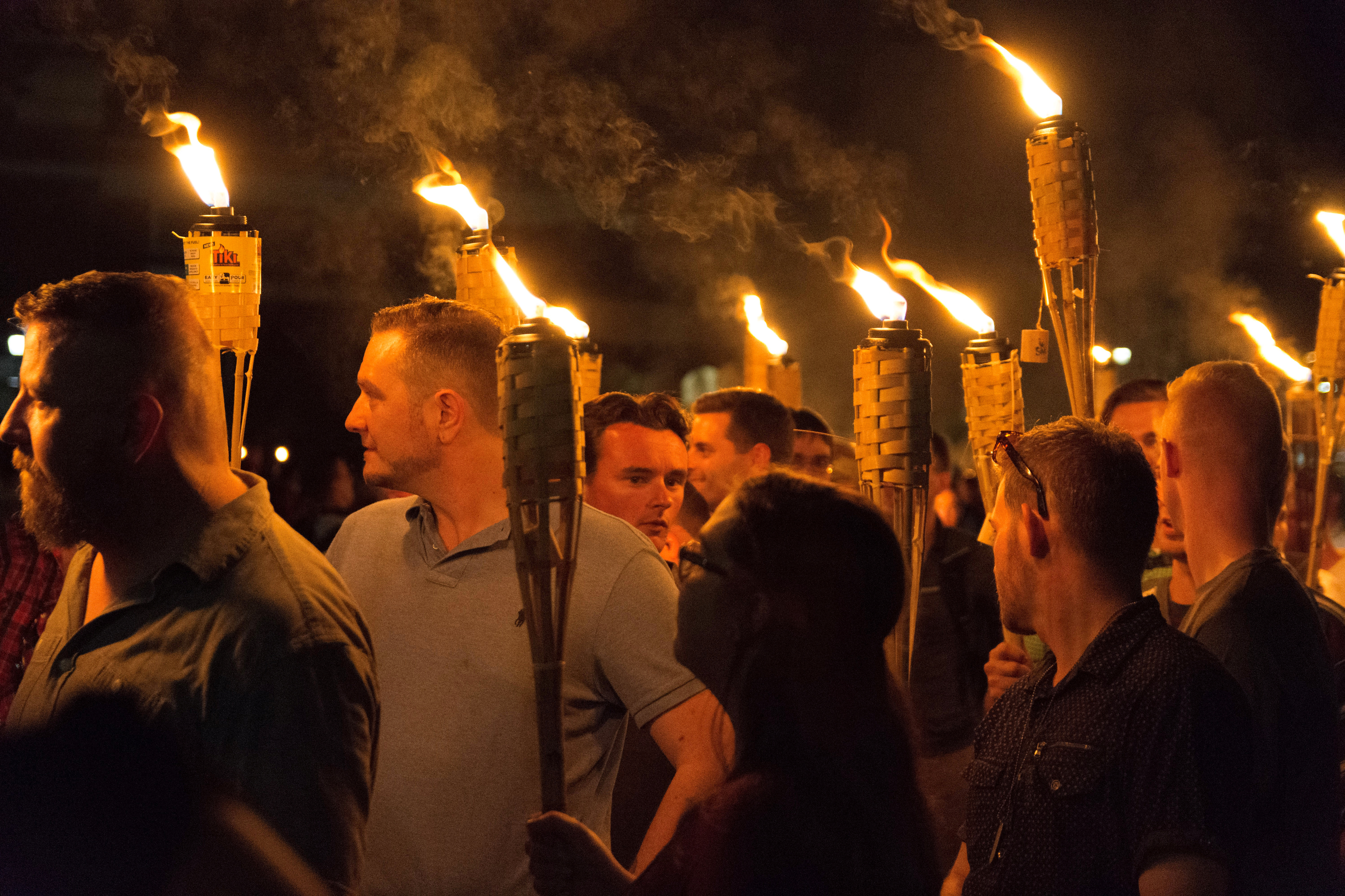 White nationalists carry torches on the grounds of the University of Virginia, on the eve of a planned Unite The Right rally in Charlottesville, Virginia, U.S. August 11, 2017. Picture taken August 11, 2017. Alejandro Alvarez/News2Share via REUTERS. MANDATORY CREDIT. NO RESALES. NO ARCHIVES - RTS1BG2B