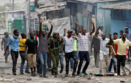 Protesters supporting opposition leader Raila Odinga attempt to make peace with policemen in Mathare, in Nairobi, Kenya