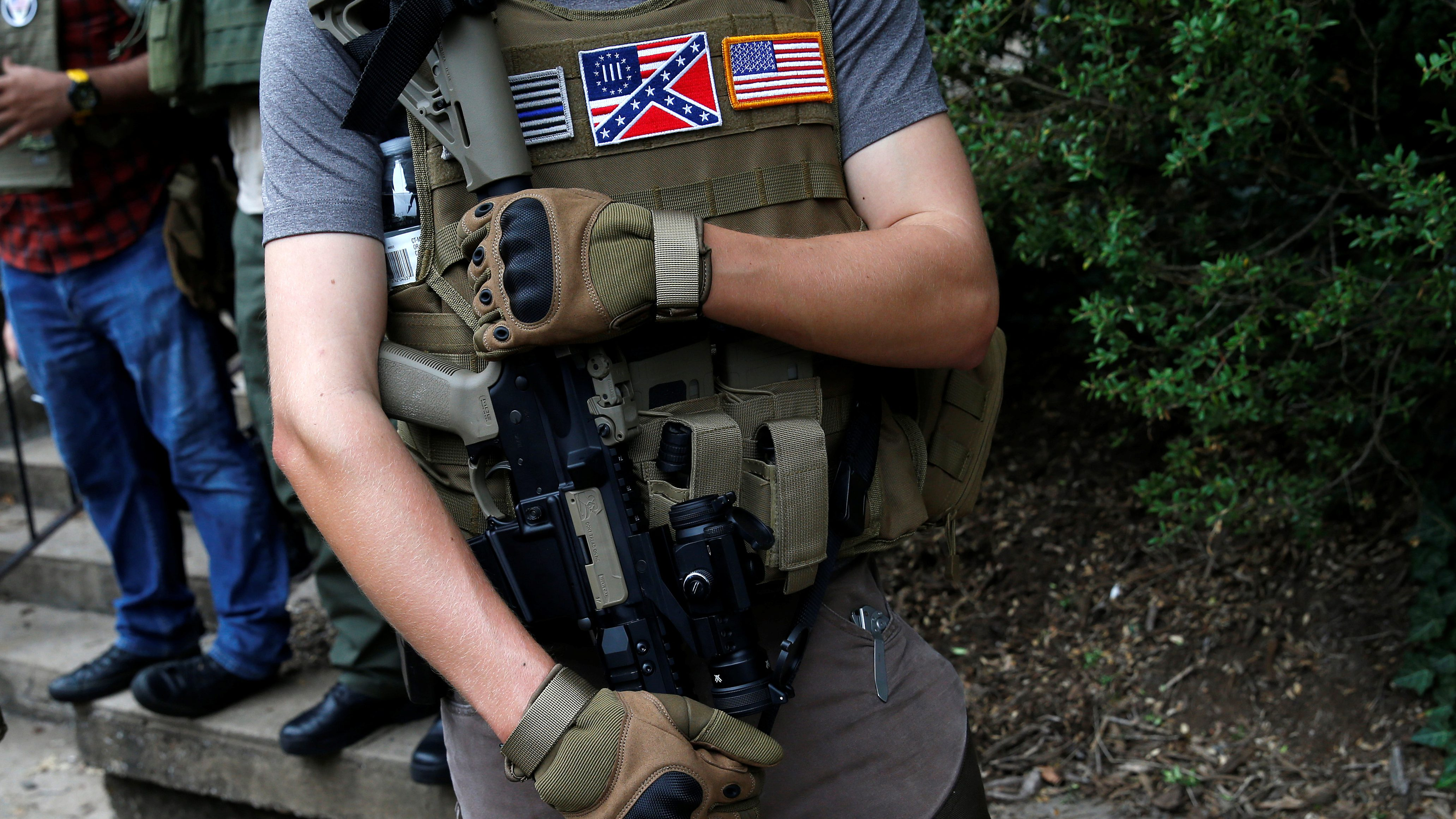 A member of a white supremacists militia stands near a rally in Charlottesville, Virginia, U.S., August 12, 2017. REUTERS/Joshua Roberts - RTS1BI6P