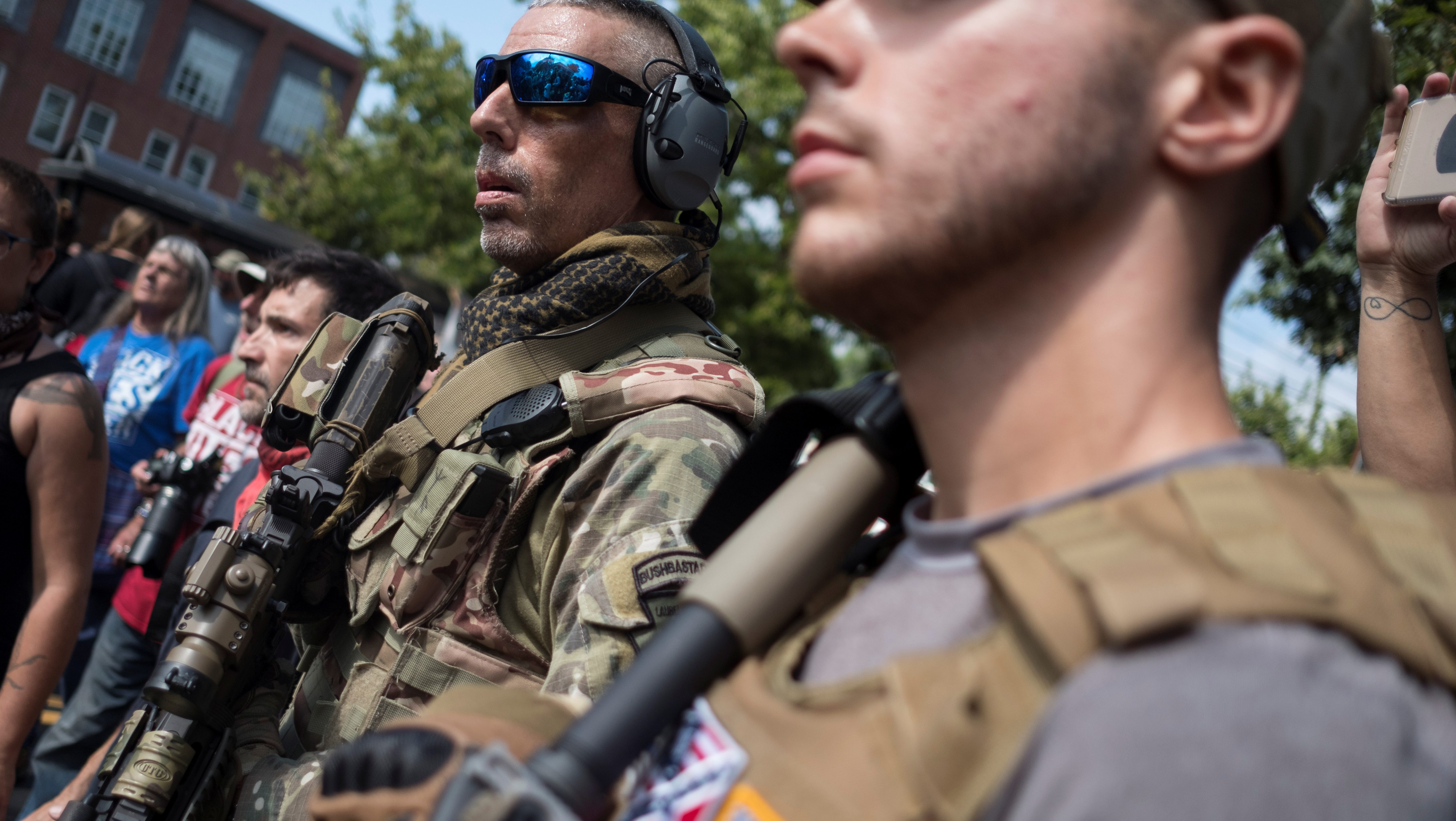 Members of a militia stand near a rally in Charlottesville, Virginia, U.S., August 12, 2017.  REUTERS/Justin Ide - RTS1BIRL