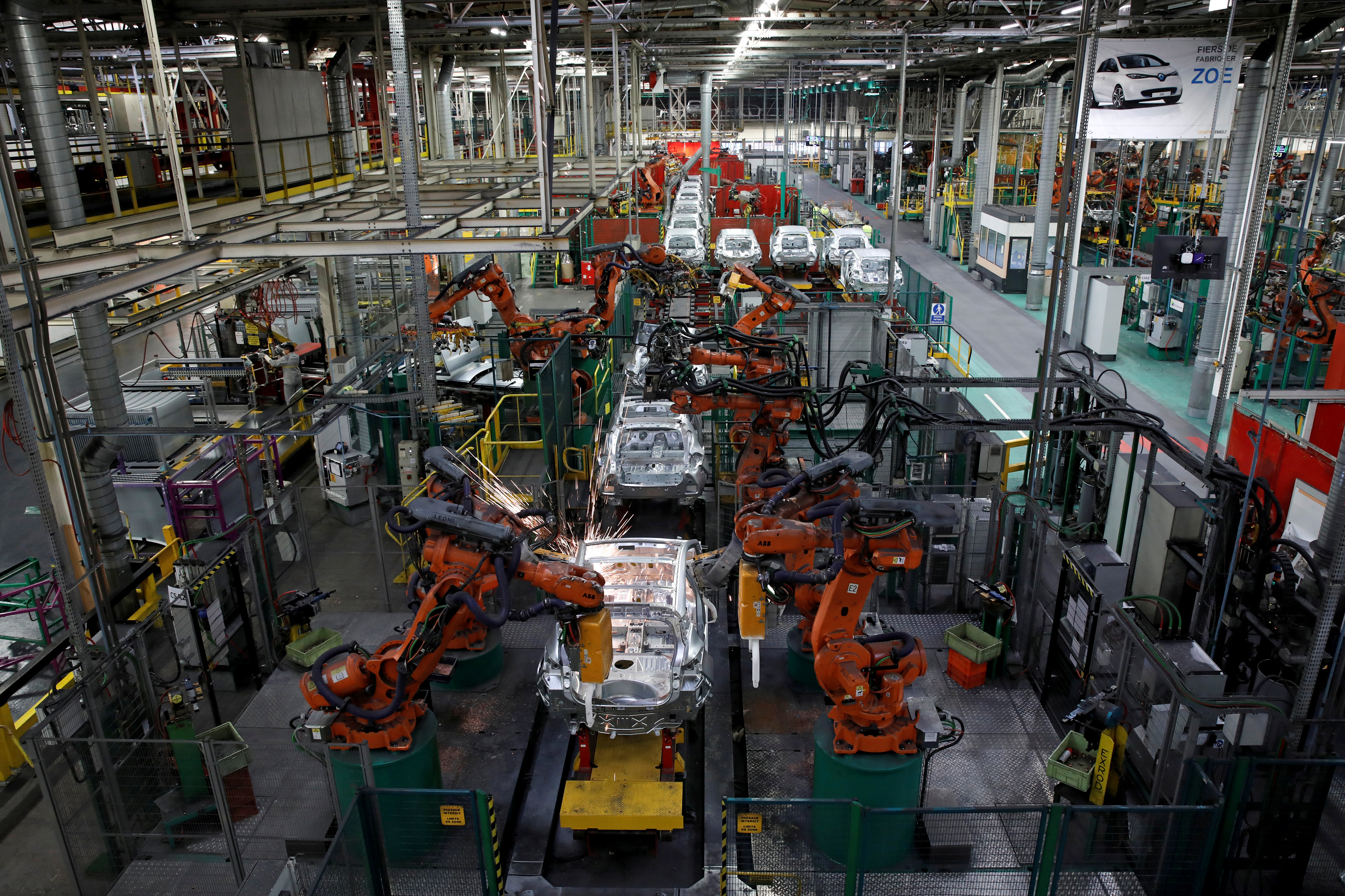 Robots assemble Renault and Nissan automobiles on the production line at the Renault SA car factory.