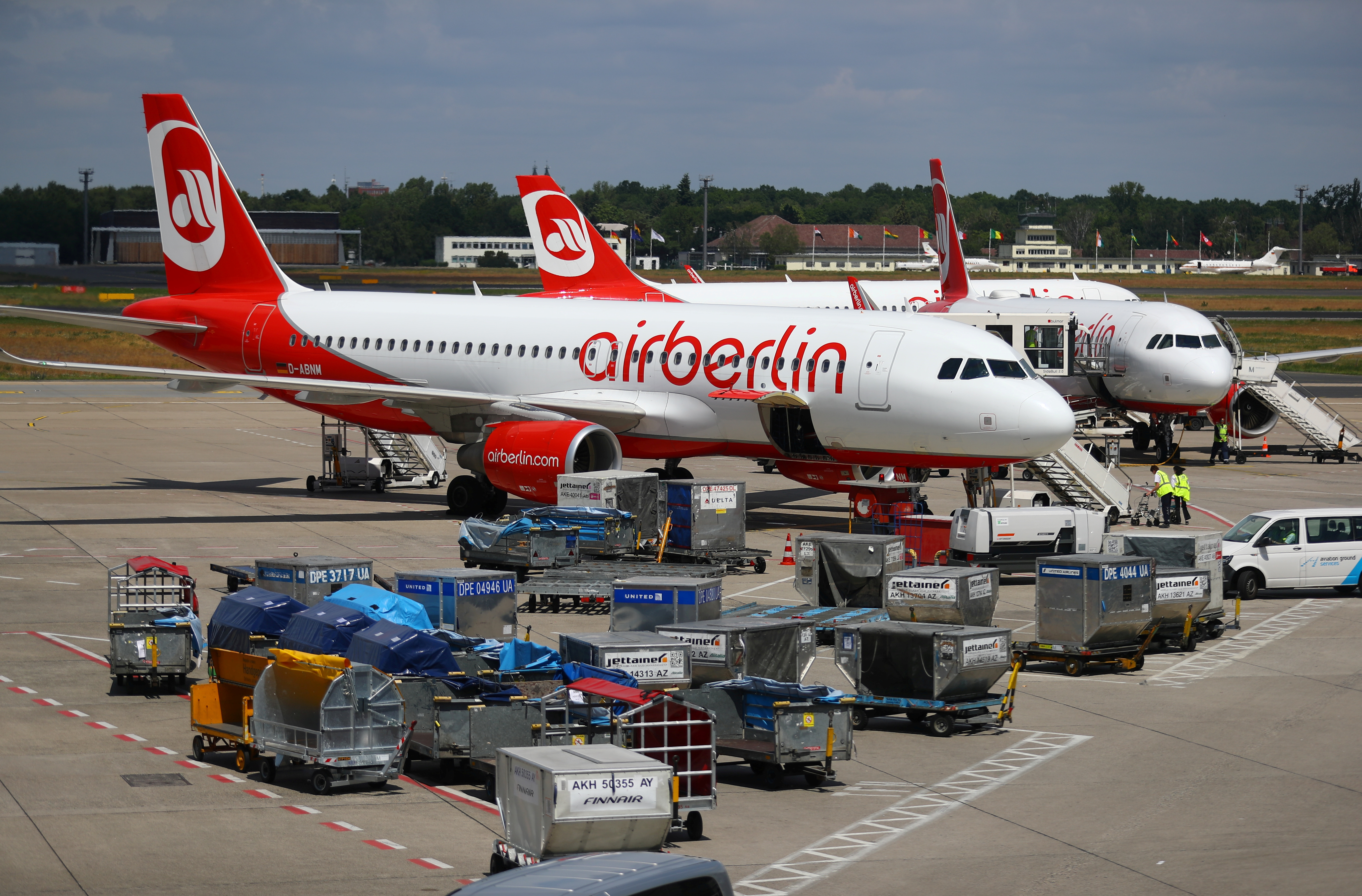 German carrier Air Berlin aircrafts are pictured at Tegel airport in Berlin, Germany, June 14, 2017. File Photo - RTS1BUYP