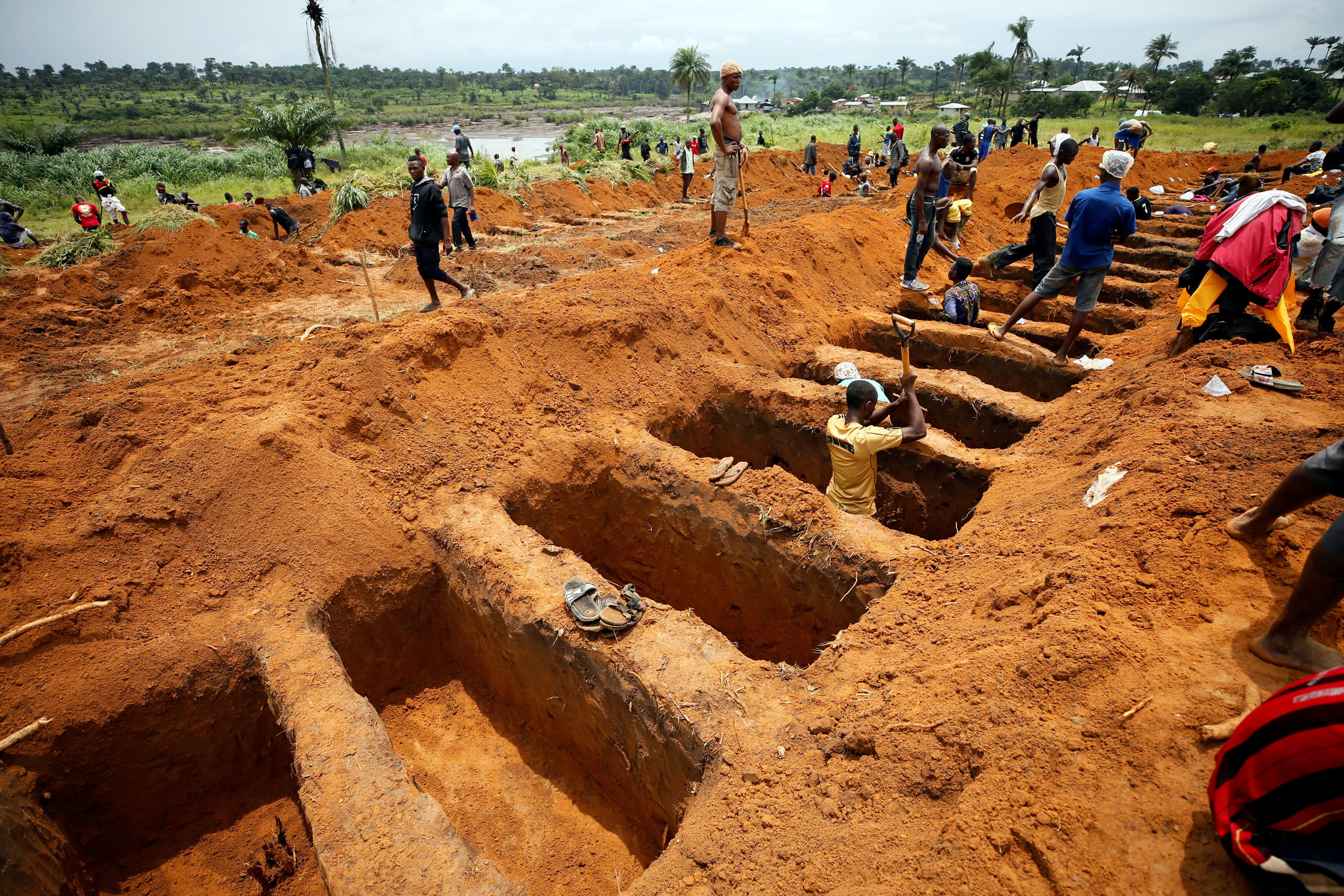 Workers are digging graves at the Paloko cemetery in Waterloo, Sierra Leone August 17, 2017.
