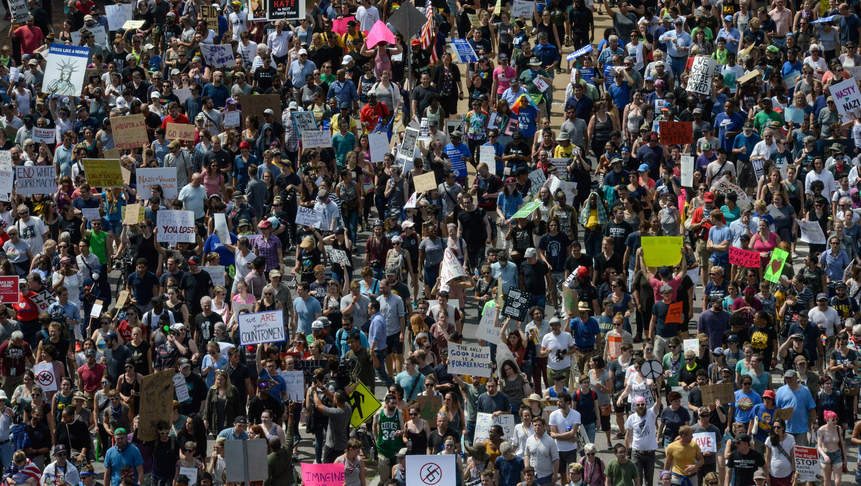 A large crowd of people march towards the Boston Commons to protest the Boston Free Speech Rally in Boston, MA