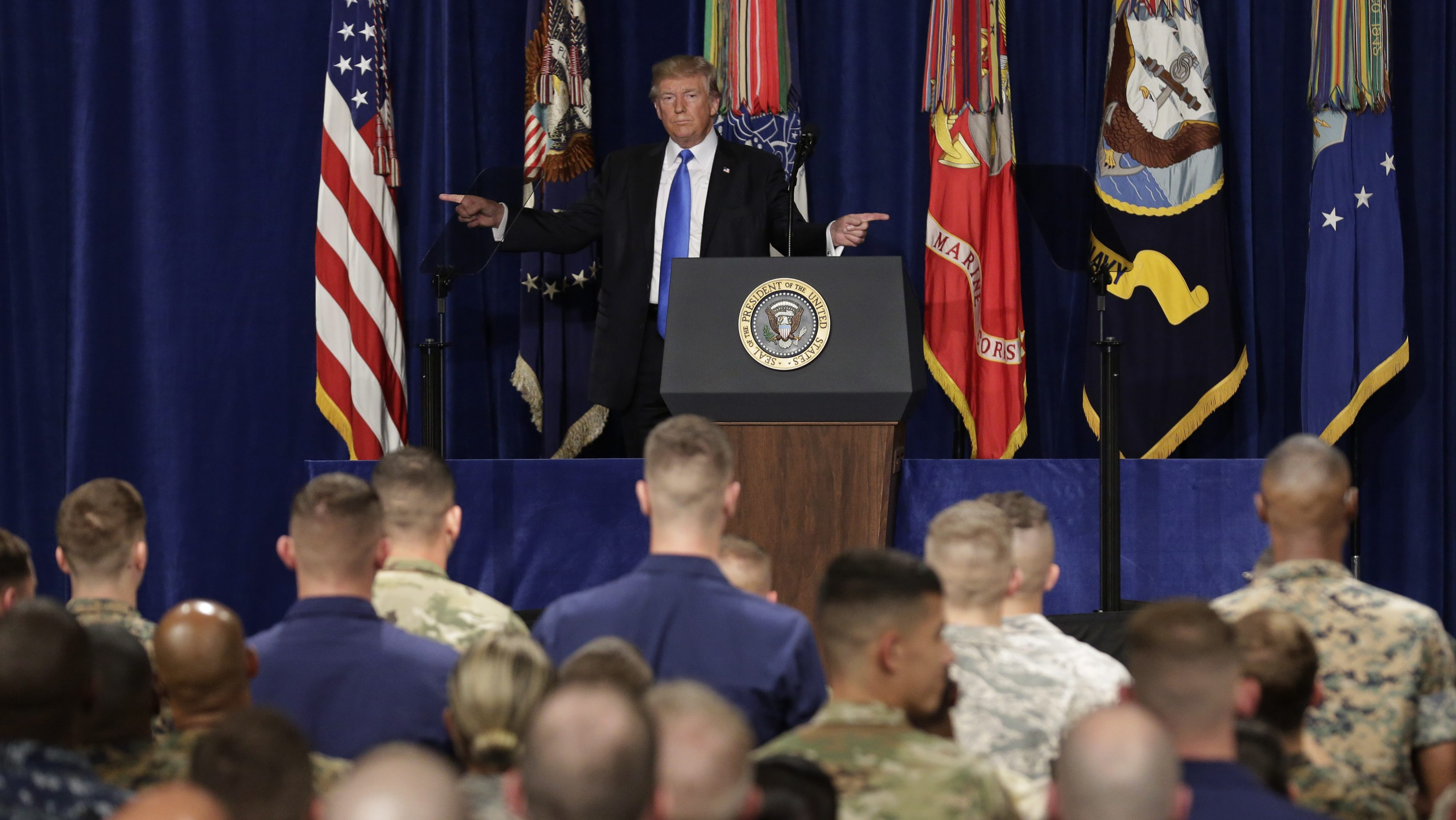 U.S. President Donald Trump gestures as he departs after announcing his strategy for the war in Afghanistan during an address to the nation from Fort Myer, Virginia, U.S., August 21, 2017.