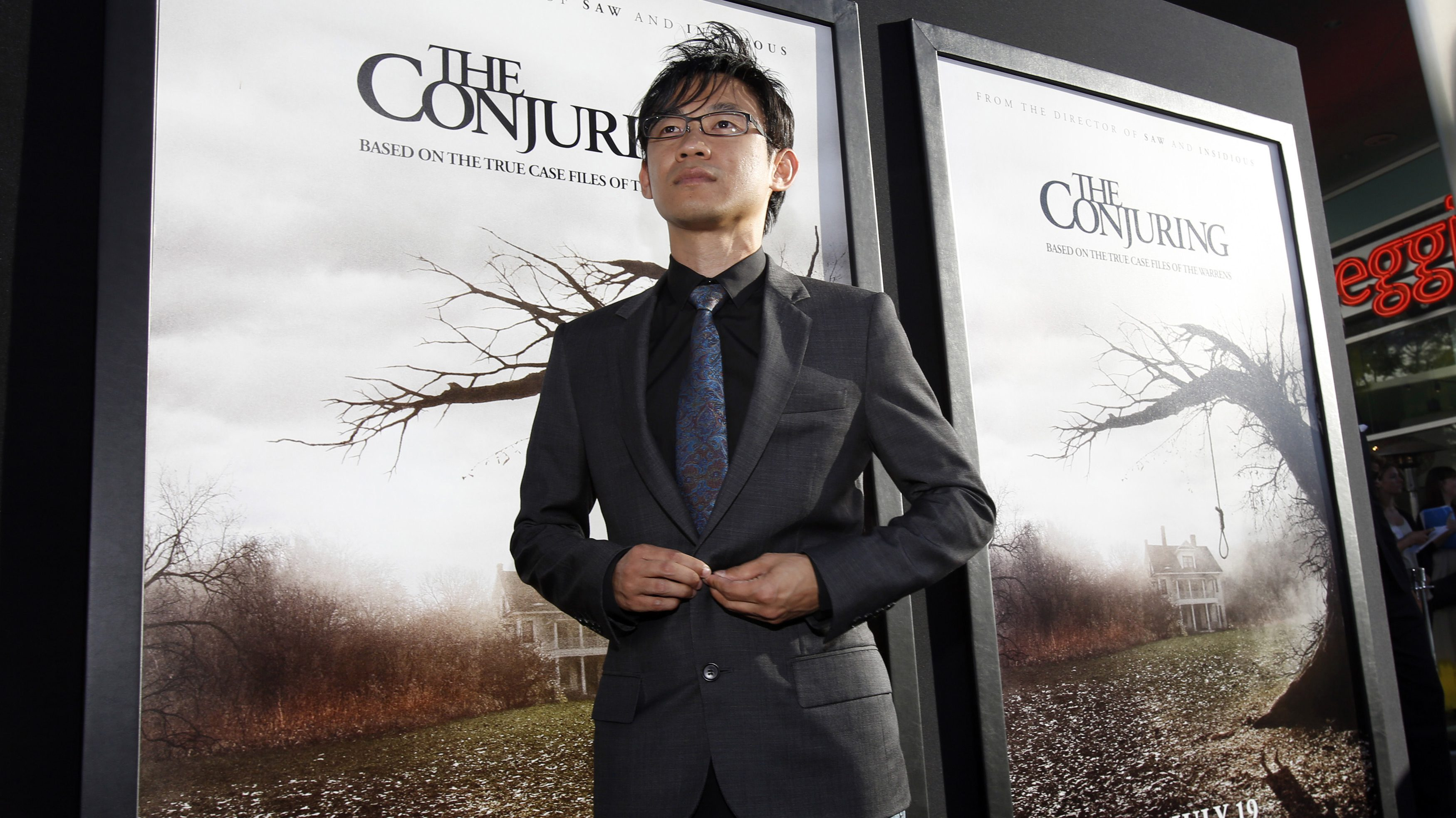 """Director of the movie James Wan poses at the premiere of """"The Conjuring"""" at the Cinerama Dome in Los Angeles, California July 15, 2013. The movie opens in the U.S. on July 19.  REUTERS/Mario Anzuoni  (UNITED STATES - Tags: ENTERTAINMENT) - RTX11NZL"""