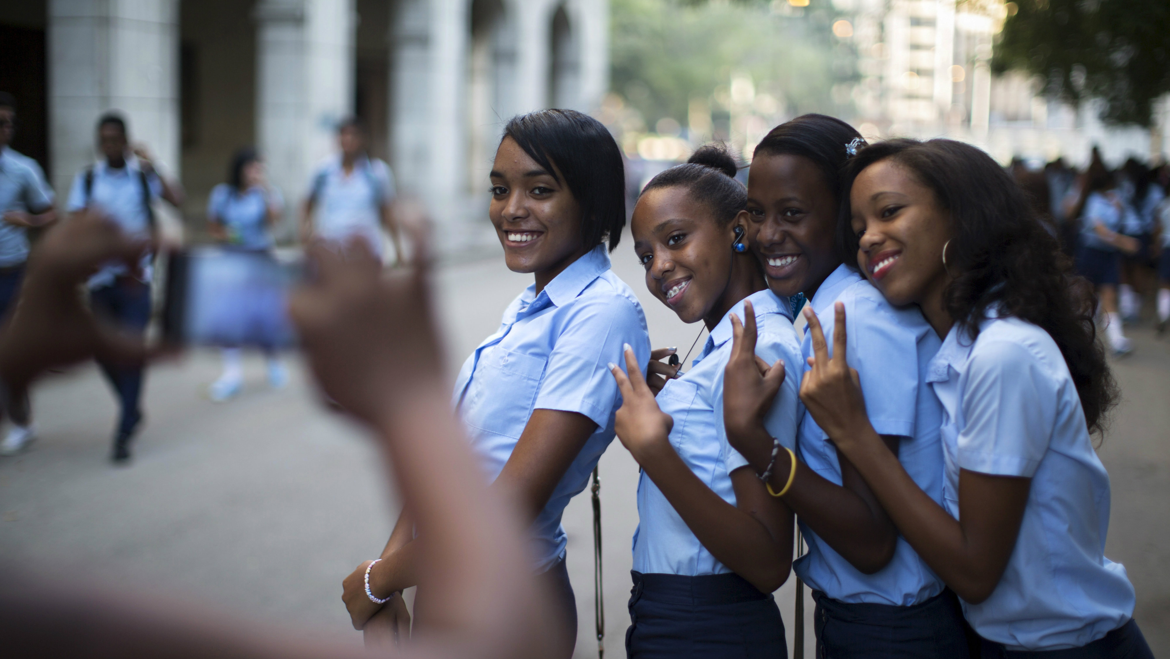 Pre-university students pose for a photo during the first day of class for the 2015-2016 course in downtown...