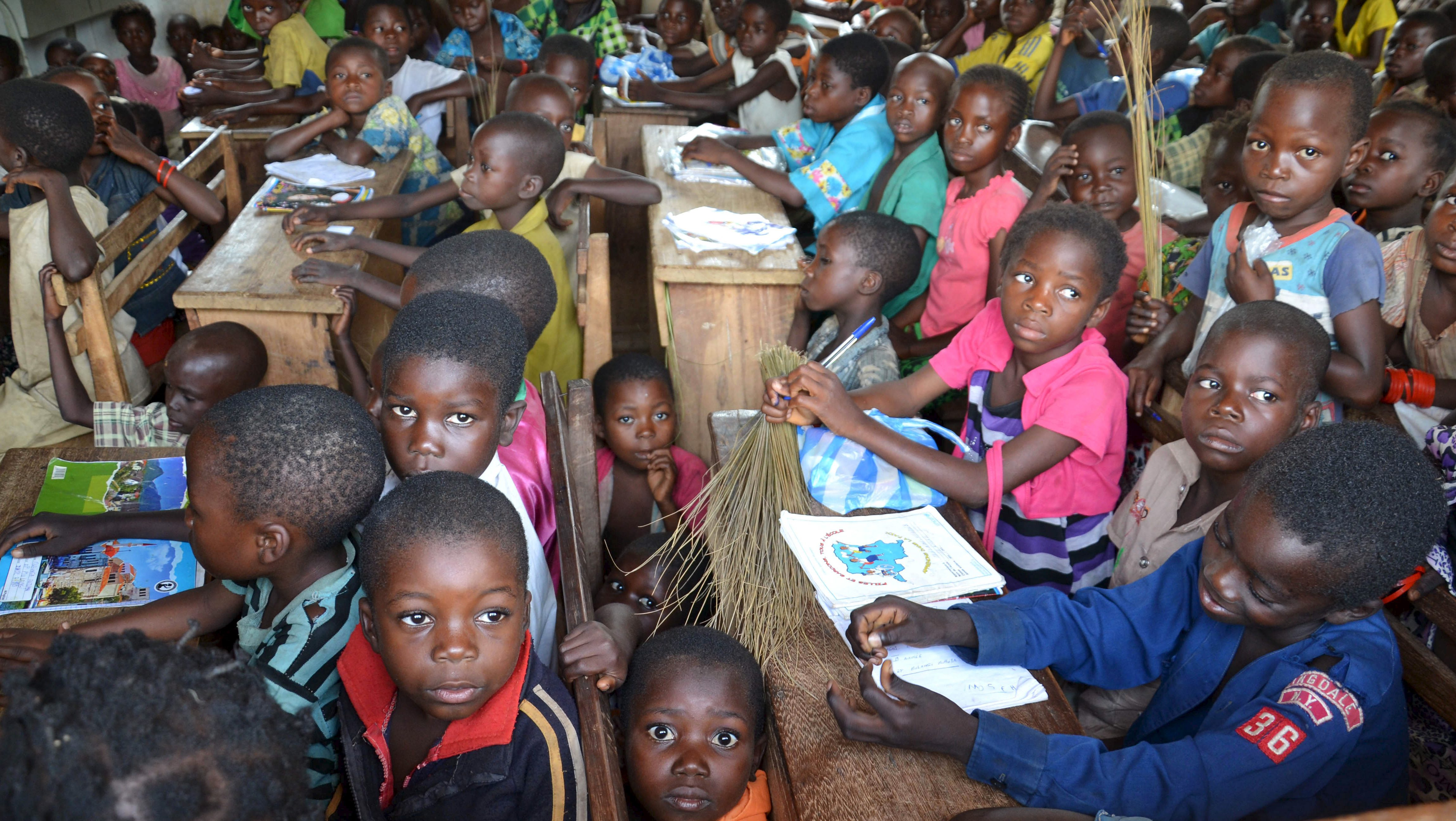 Children from the Bantu and Pygmy communities attend a class at a school in Muhuya, in southeastern Democratic Republic of the Congo