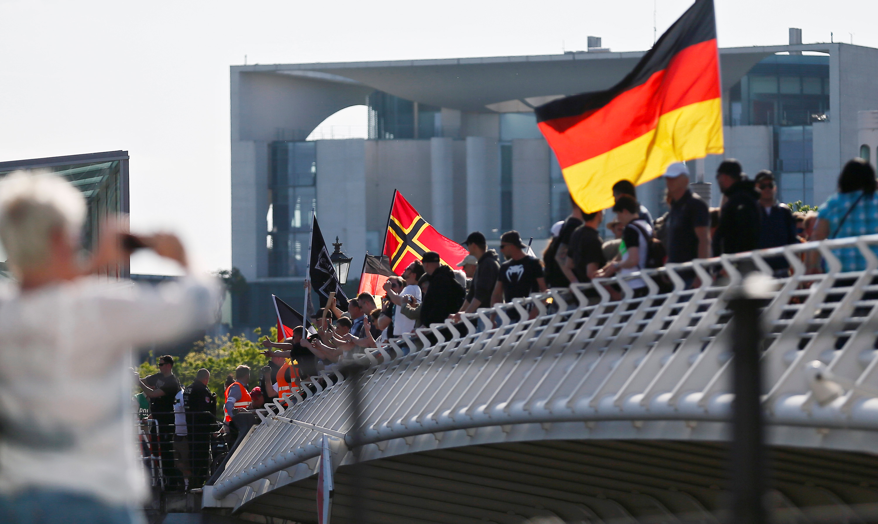 Right-wing protestors demonstrate against refugees, Islam and German Chancellor Angela Merkel in front of the chancellery in Berlin, Germany, May 7, 2016.