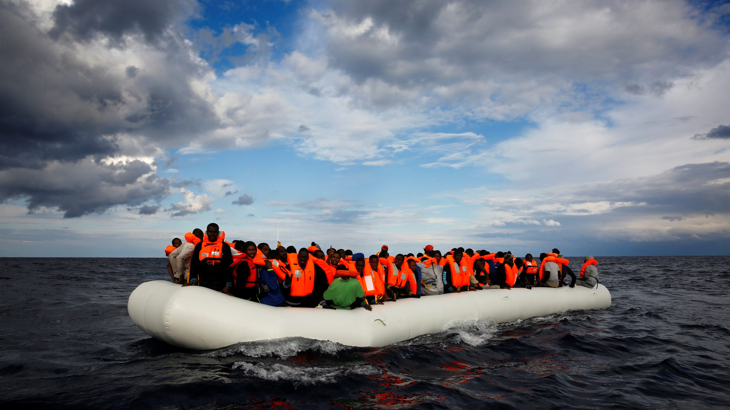 An overcrowded raft drifts out of control in the central Mediterranean Sea