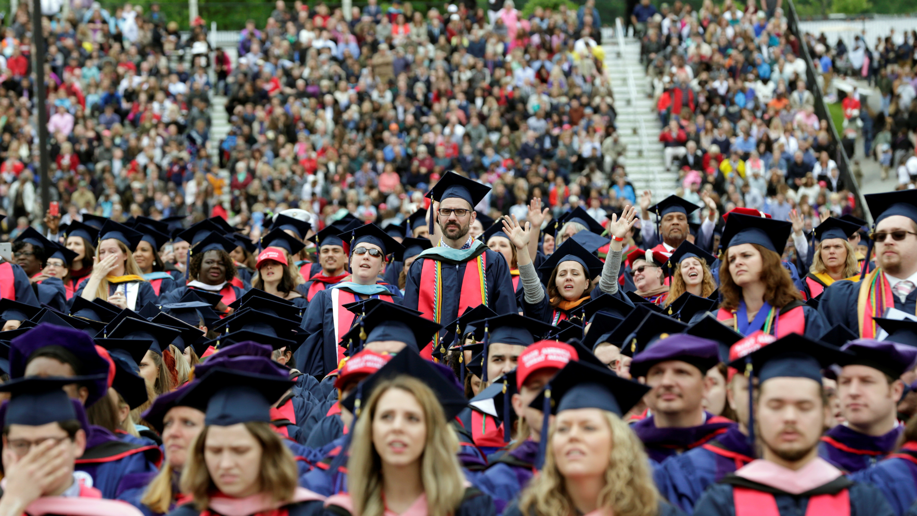 Graduating students attend a commencement ceremony with U.S. President Donald Trump at Liberty University  in Lynchburg, Virginia, U.S., May 13, 2017. REUTERS/Yuri Gripas - RTX35OMY