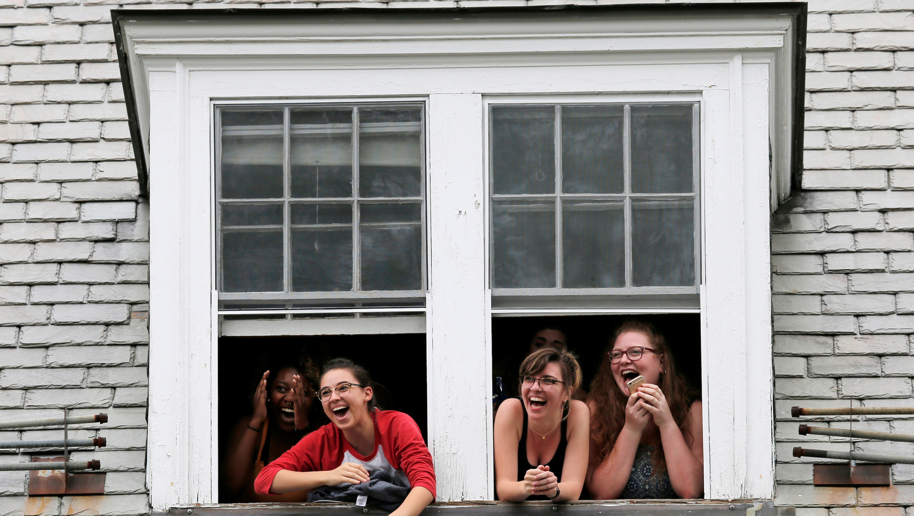 Students watch Commencement ceremonies from an overhead window at Smith College in Northampton, Massachusetts, U.S., May 21, 2017.   REUTERS/Brian Snyder - RTX36W2X