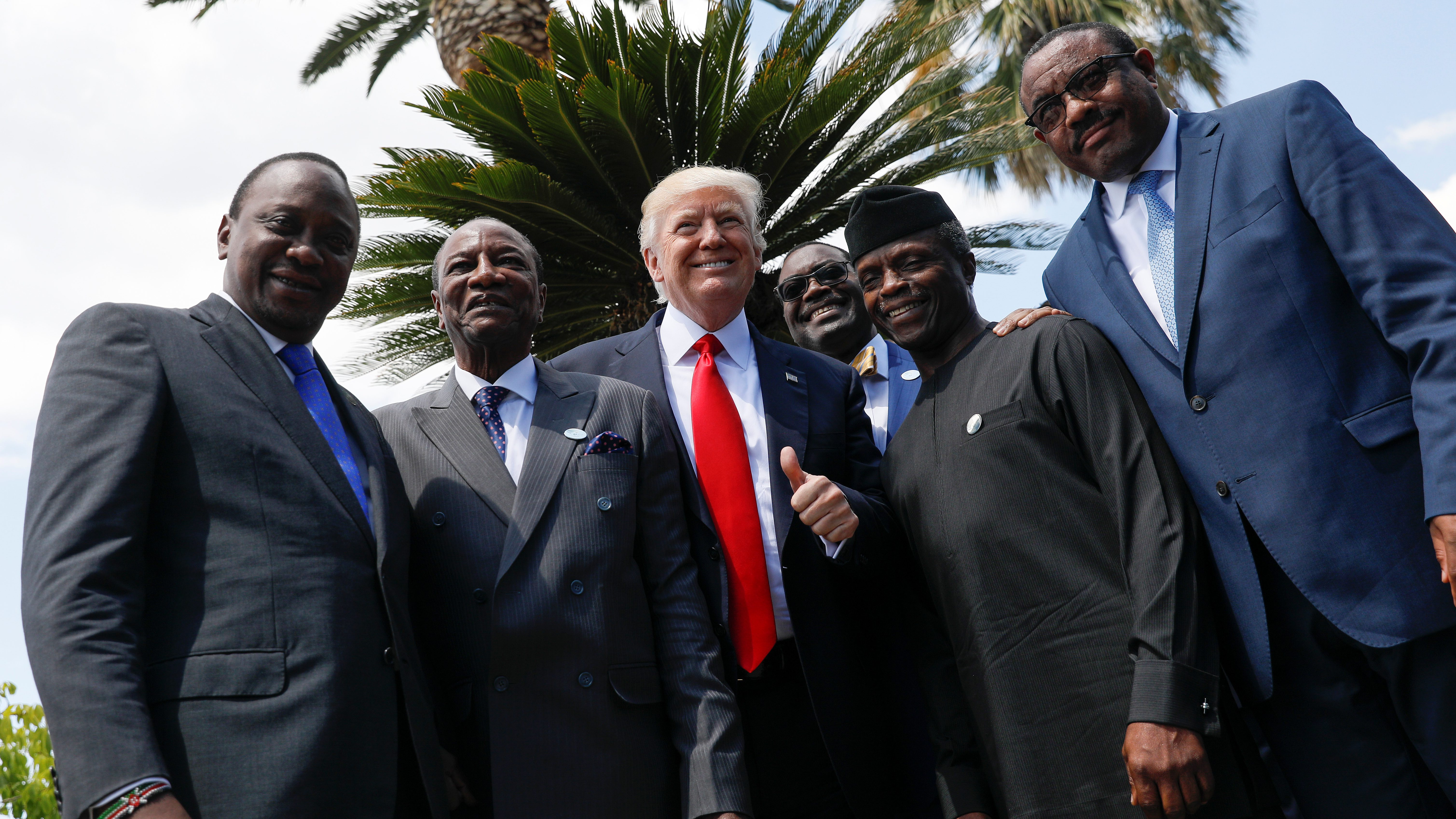 Trump poses with African leaders following family photo of the G7 Summit expanded session in Taormina